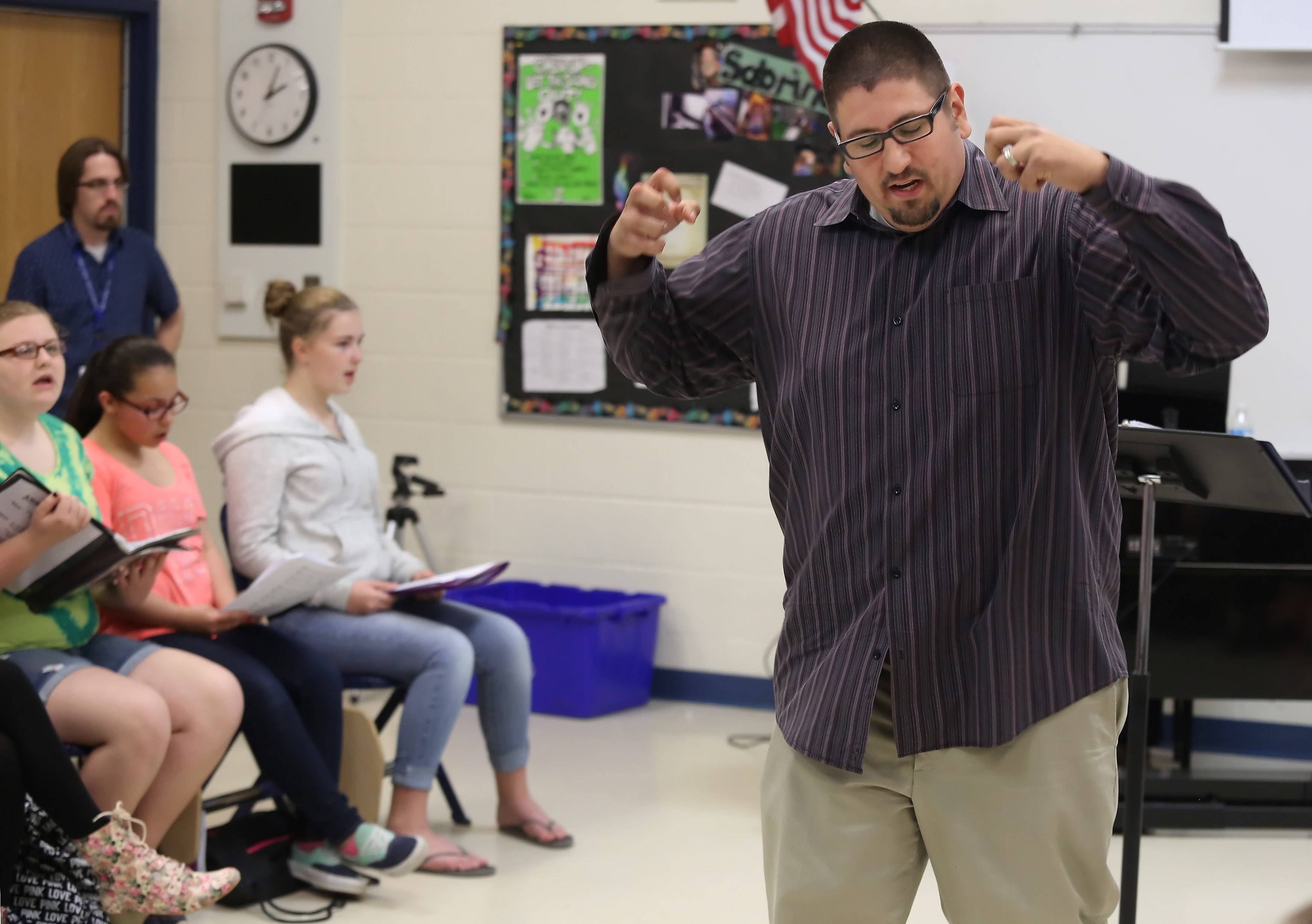 Round Lake Middle School music teacher Javier Diaz is known for his enthusiasm when he conducts the choir program.