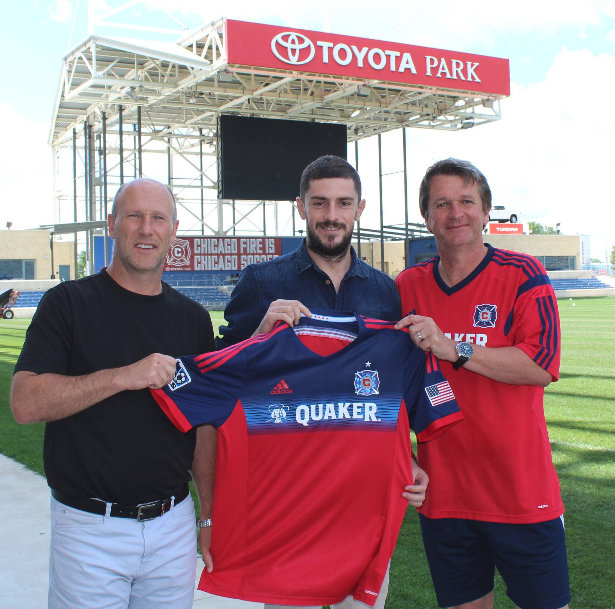 Veteran Romanian midfielder Razvan Cocis, flanked by technical director Brian Bliss, left, and head coach Frank Yallop, right, has signed to play for the Chicago Fire.
