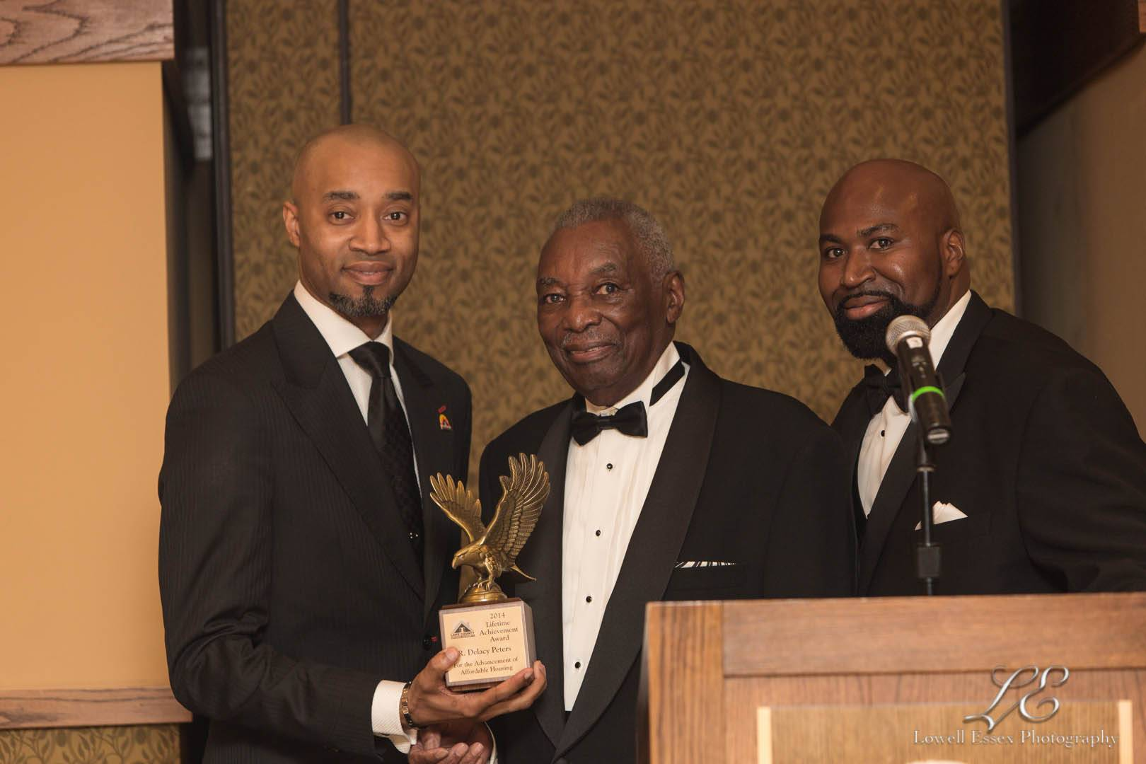 Lifetime Achievement Award Recipient R. Delacy Peters (center) given by Executive Director/CEO David A. Northern, Sr. (right) and Pastor H. Lee Jordan, Jr. (left)LCHA