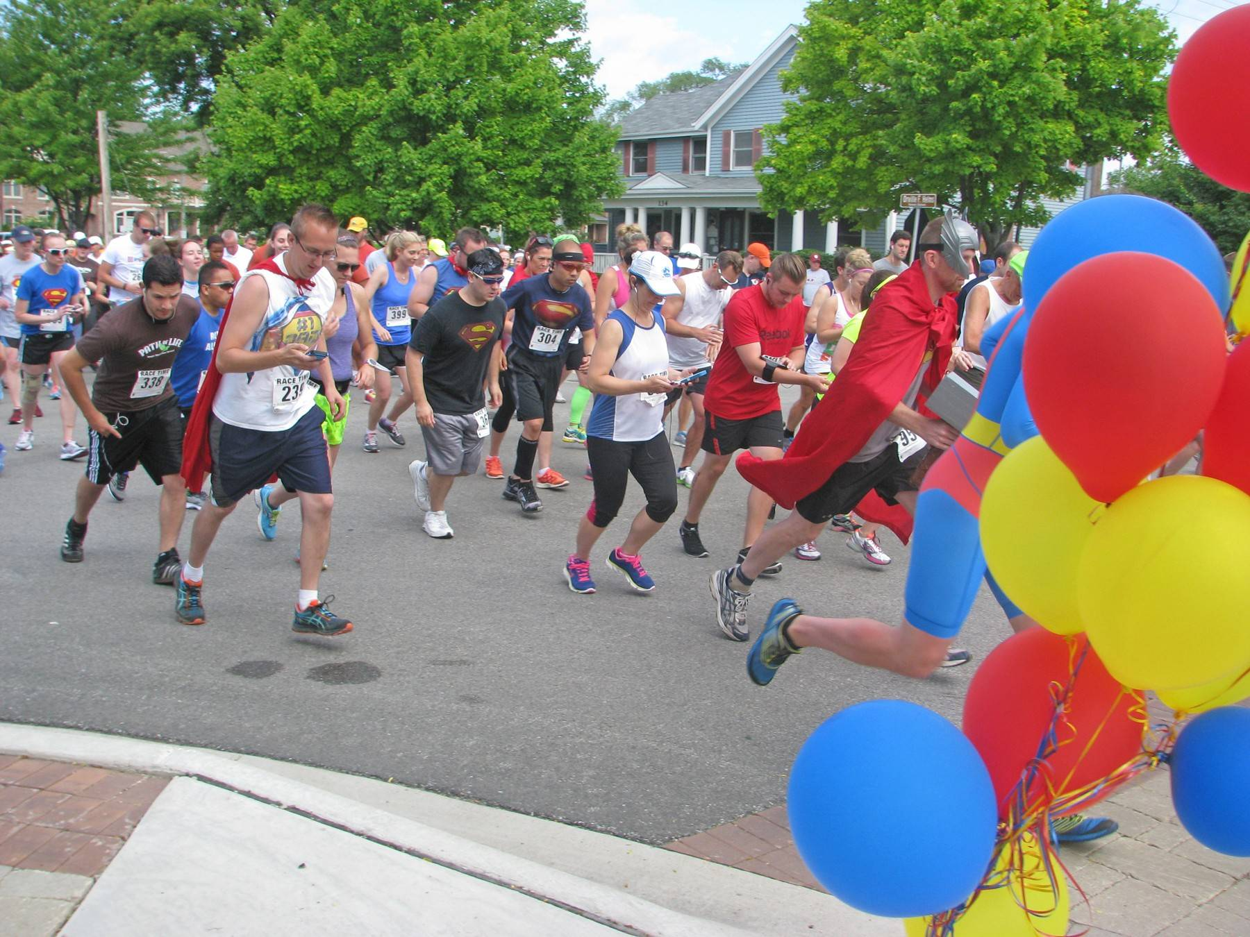 Superheroes of all kinds and ages run toward the goal of helping the area's homeless on Saturday, June 28, during JOURNEYS | The Road Home's 5K Superhero Race/1 Mile Super Stroll.