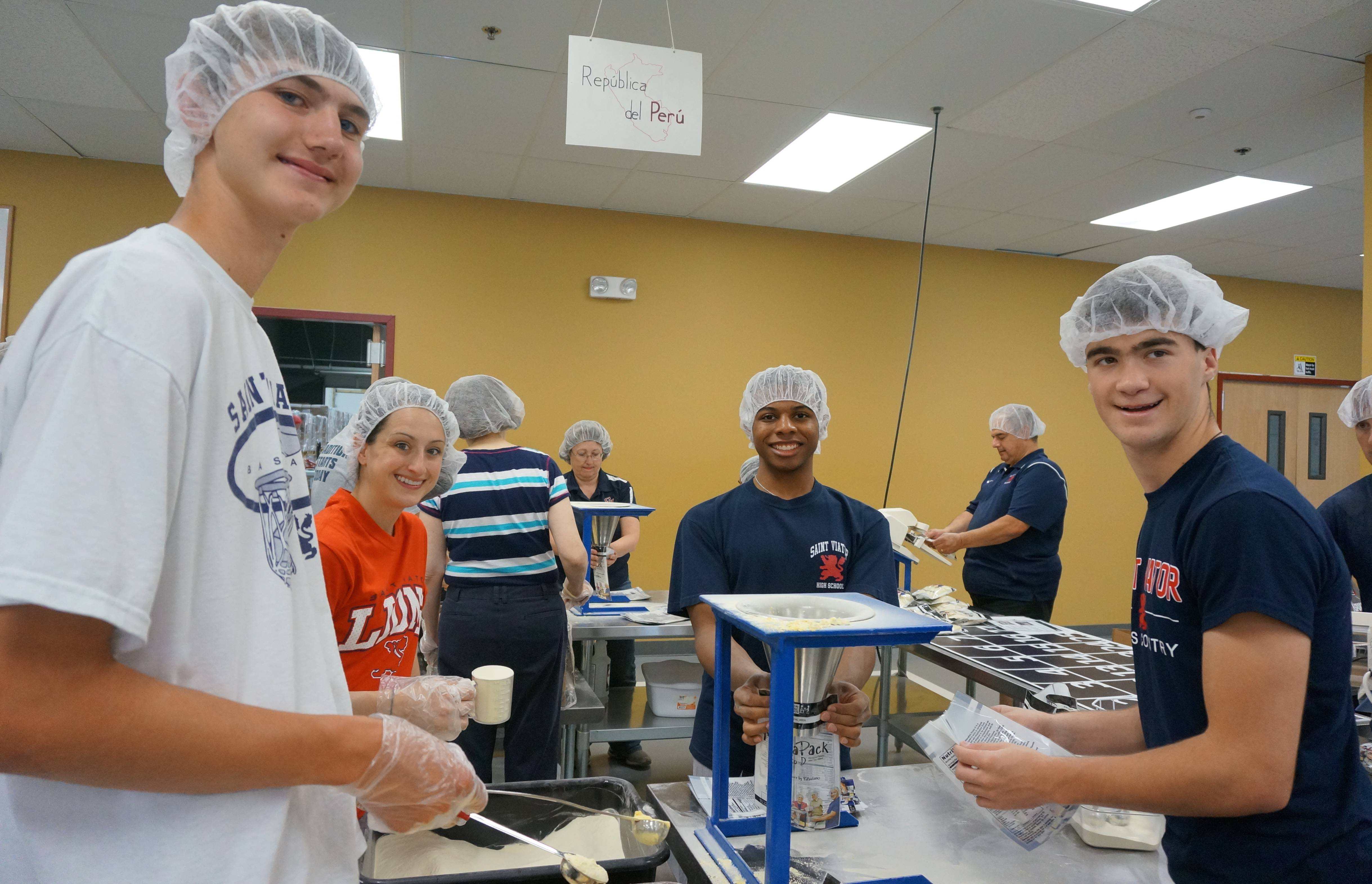 Participating in the meal-packing event at Feed My Starving Children in Libertyville are St. Viator alumni (l to r) Matt Trimberger, Barrington, Sara Wells, Palatine, Paul Lewis, Hoffman Estates and Patrick Spanier, Mount Prospect.Toni Antonetti