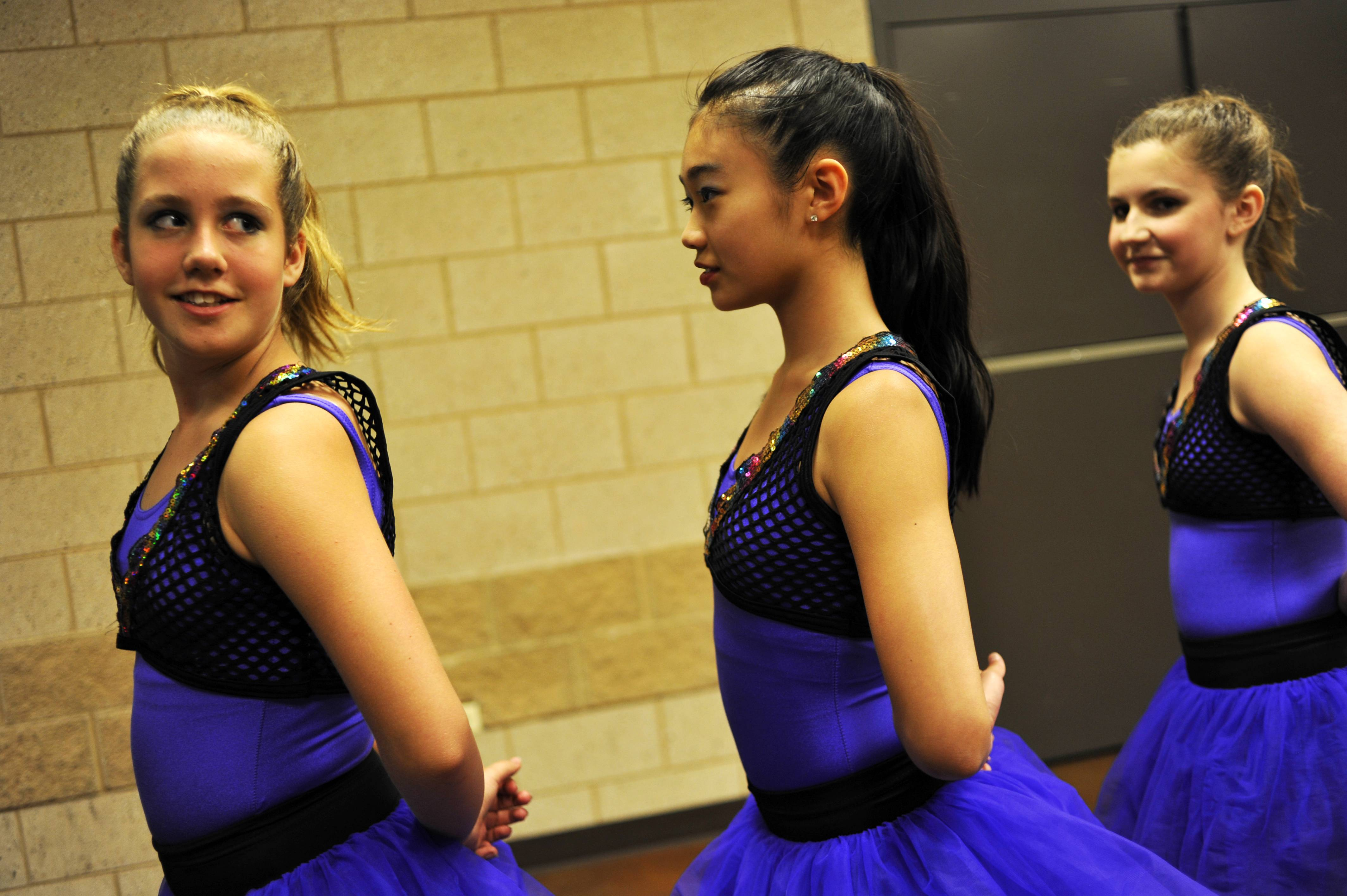 "From left, Karlee Smith, 13, Alissa Chu, 12, and Haley Beilfuss, 13, all of Batavia, wait to go onstage Monday at the Kane County Talent Show at Kane County Fairgrounds in St. Charles. The girls danced jazz and hip-hop to the song ""Invade."""
