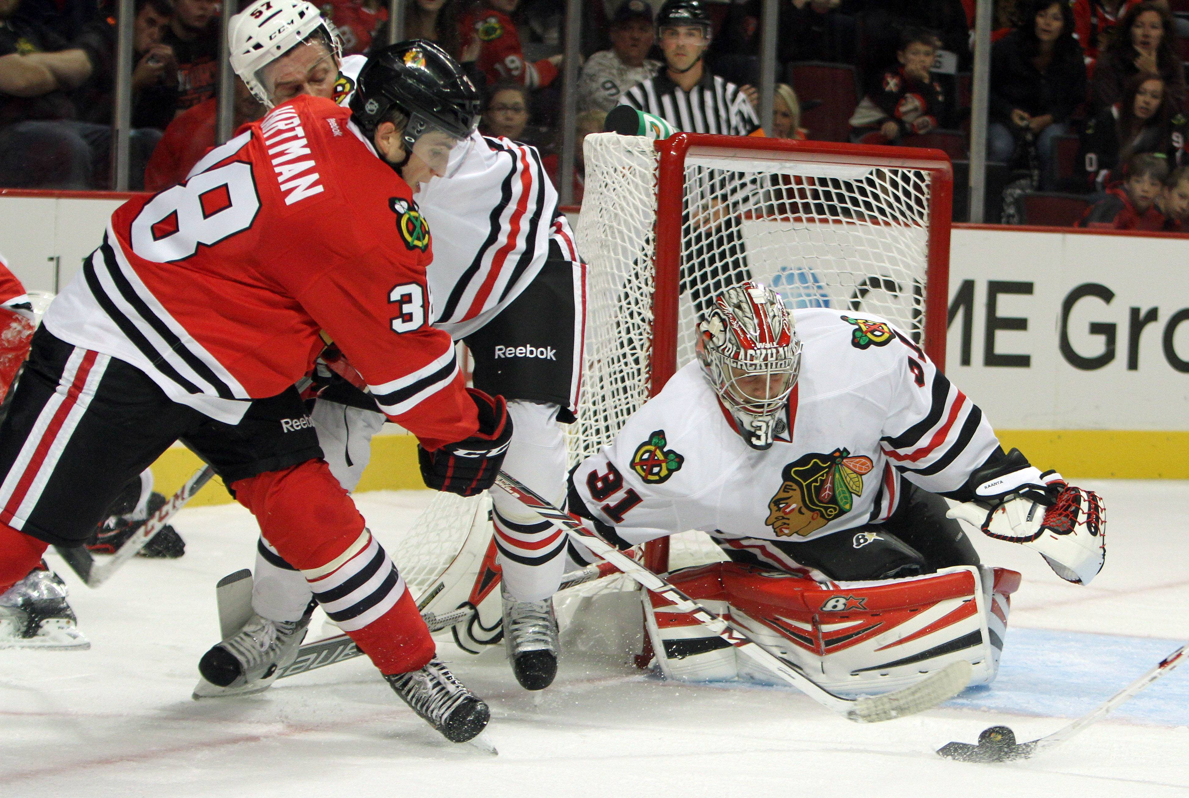 Ryan Hartman shoots on Antti Raanta during the Blackhawks' camp last September. t's been a whirlwind year for the West Dundee native and top Hawks prospect.
