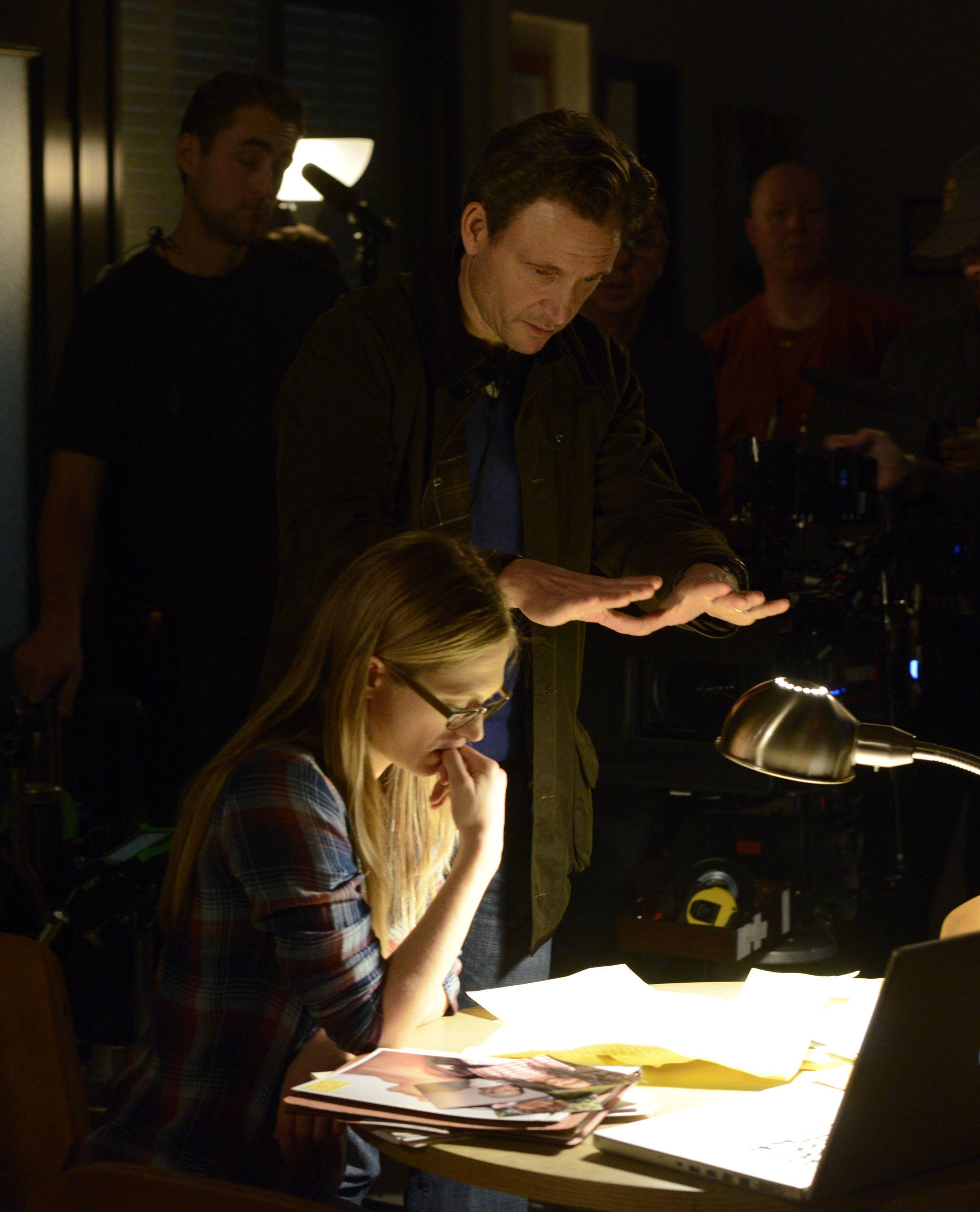 "Director Tony Goldwyn with actress Marin Ireland on the set of ""The Divide."""