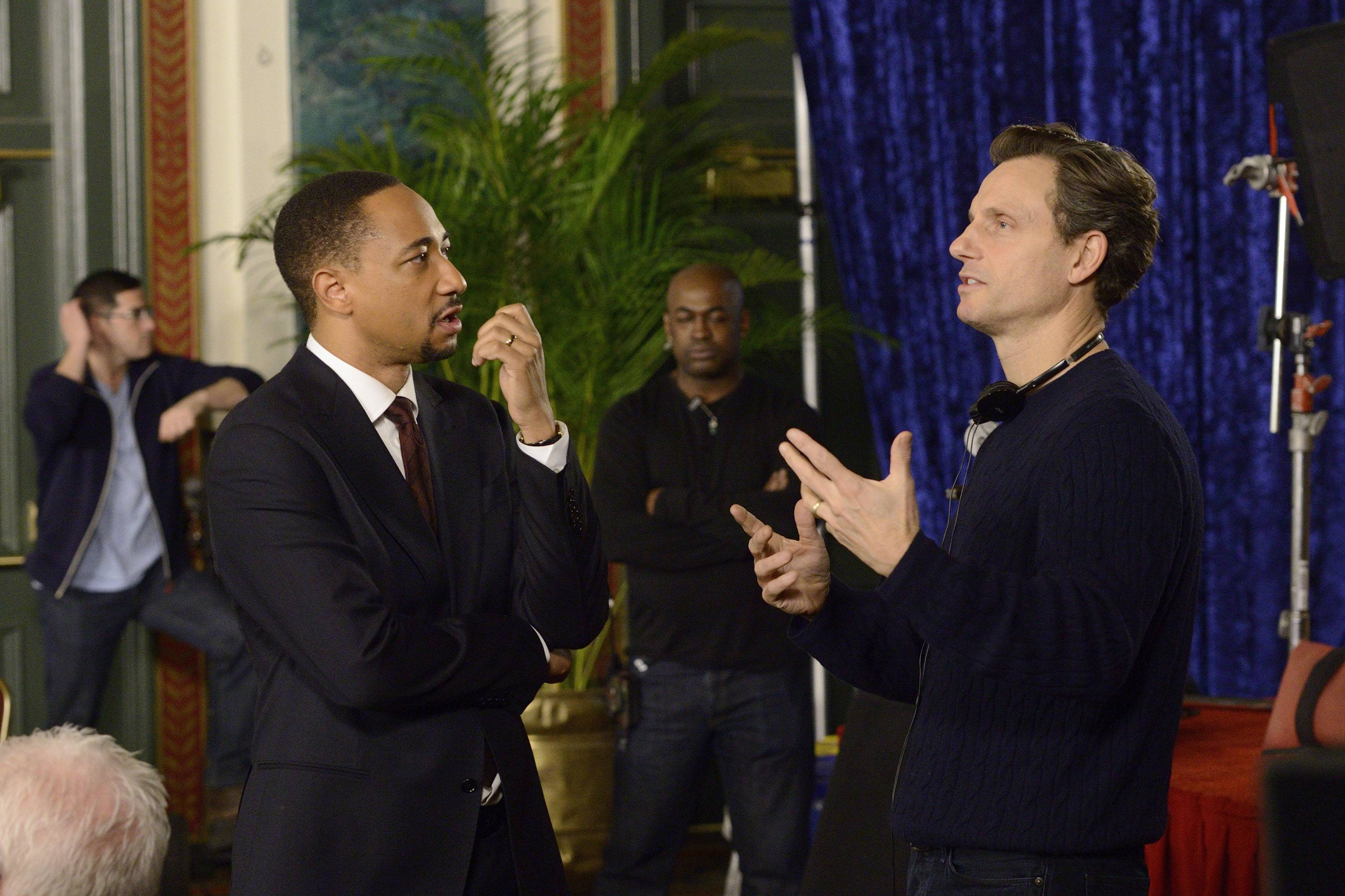 "Actor Damon Gupton, left, and director Tony Goldwyn on the set of ""The Divide."" The series premieres Wednesday, July 16, at 8 p.m."