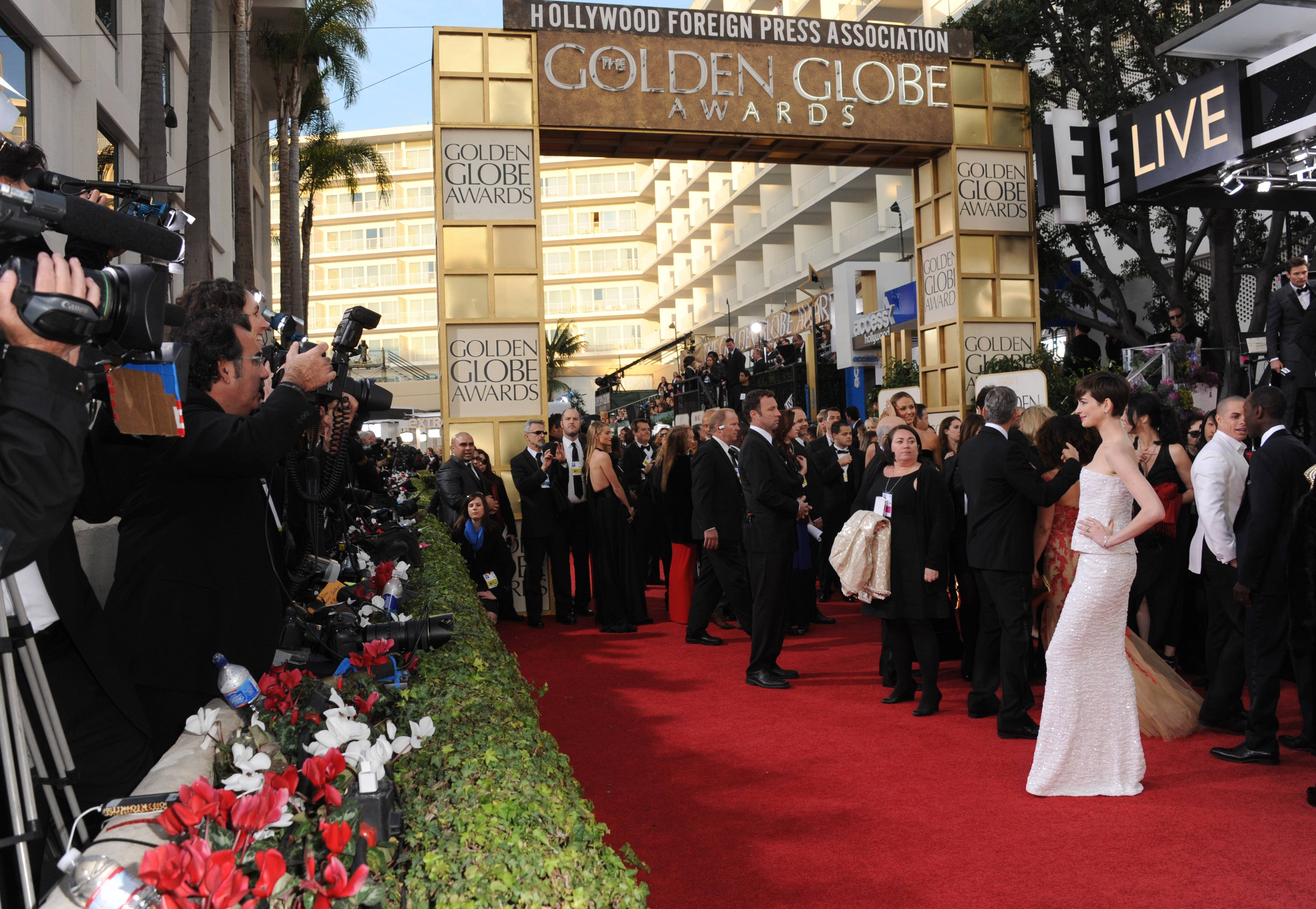 The organization that puts on the Golden Globe Awards and the company that produces the telecast have resolved their long-standing court battle over rights to the show.
