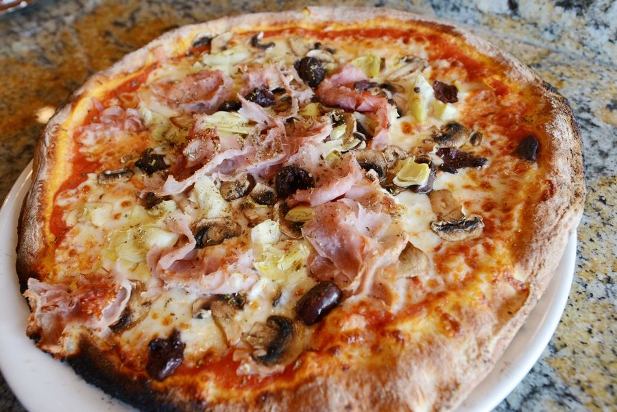 Elio's Pizza on Fire's Capricciosa pizza features plum tomatoes, artichokes, ham, mushrooms and olives.