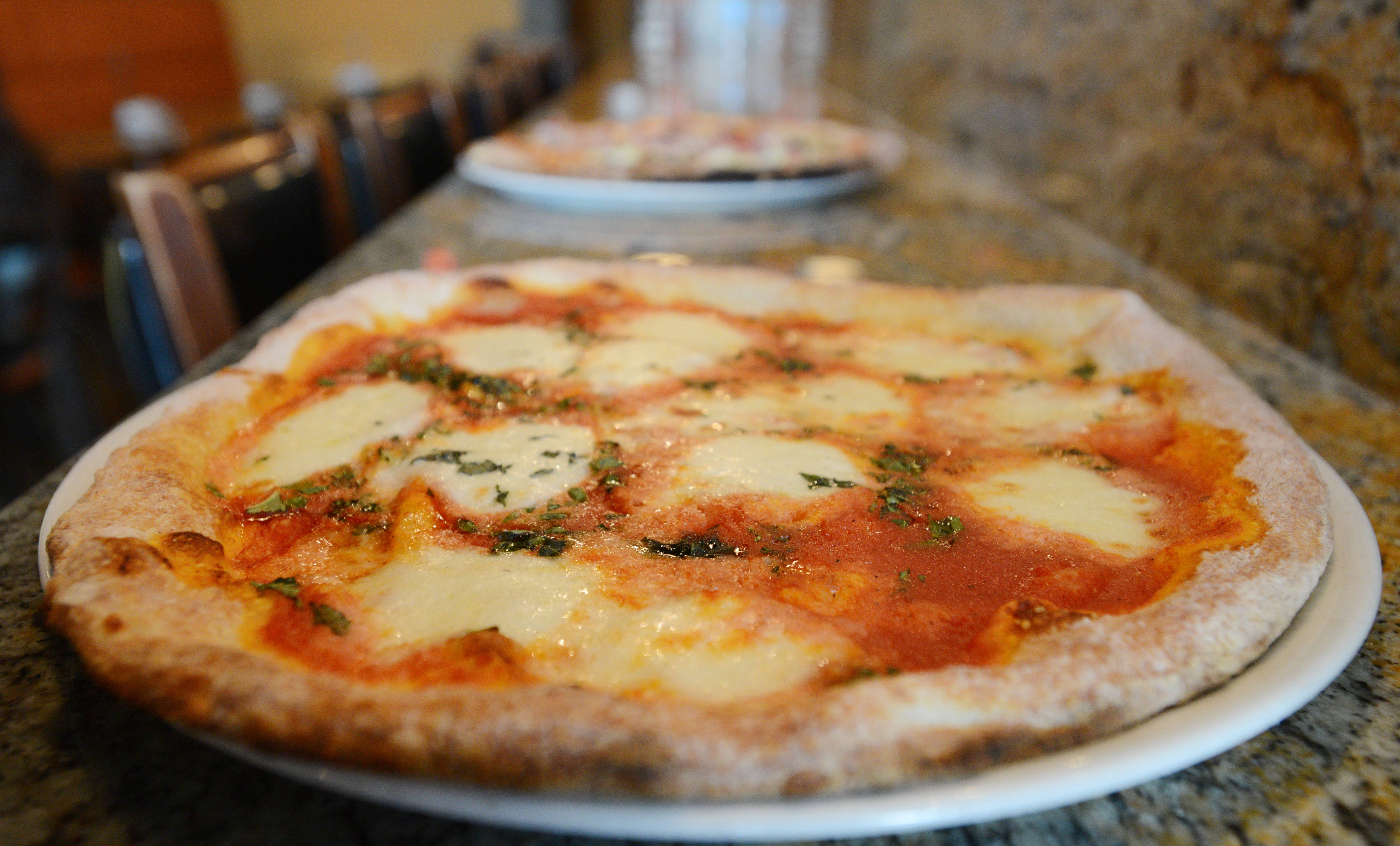 Pizzas from the traditional -- like this Margherita pie -- to more exotic versions with salmon and capers are on the menu at Elio's Pizza on Fire.