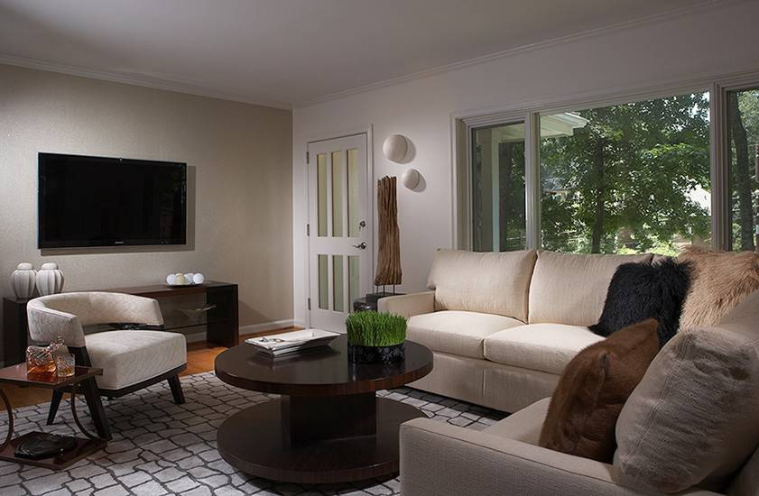 Living room furniture can be placed either on or off an area rug.