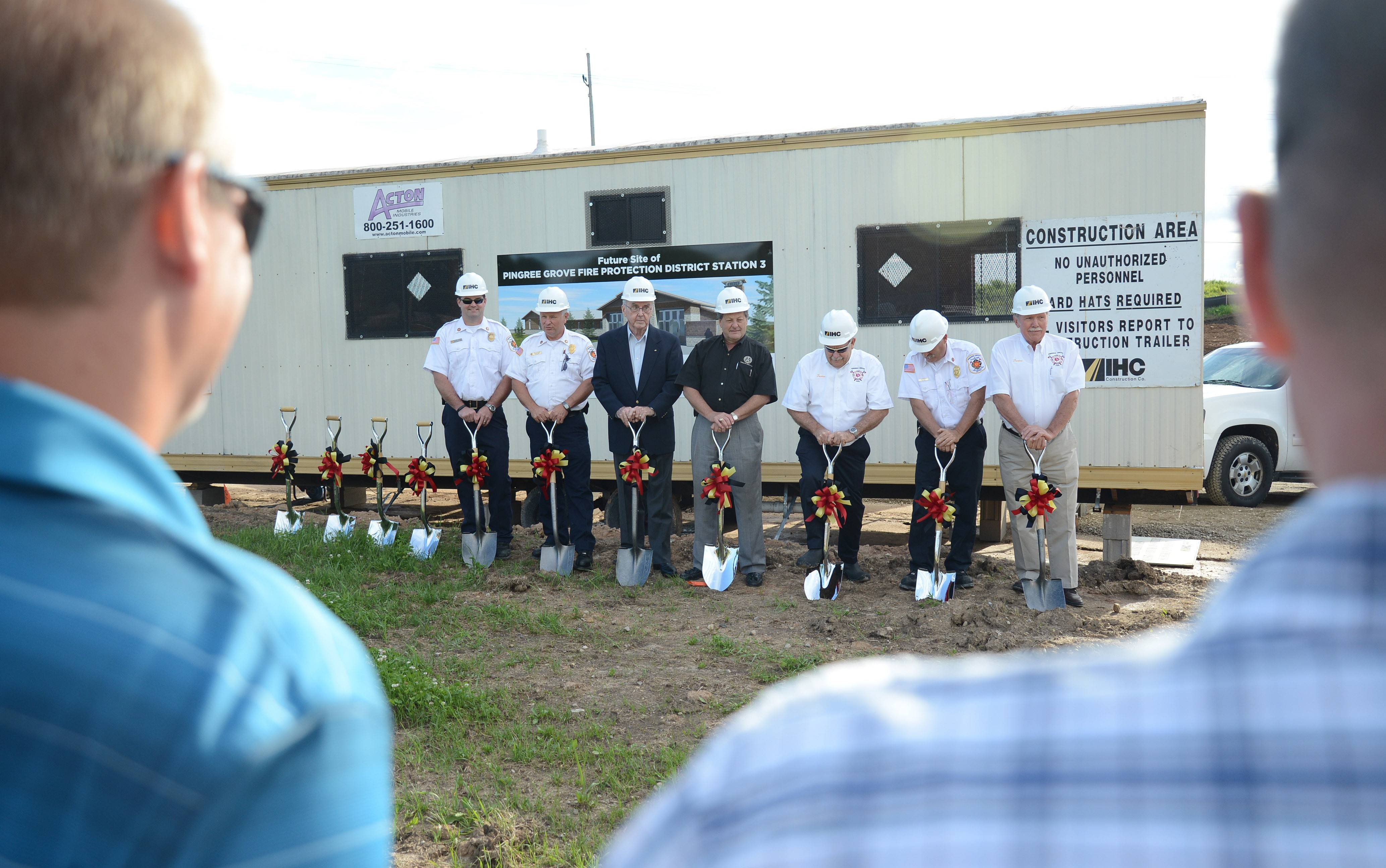 Pingree Grove & Countryside Fire Protection District trustees pose for formal photos at the groundbreaking of a new $3.3 million fire station on Tuesday evening. The station is being built near the Cambridge Lakes North, or Carillon, subdivision.