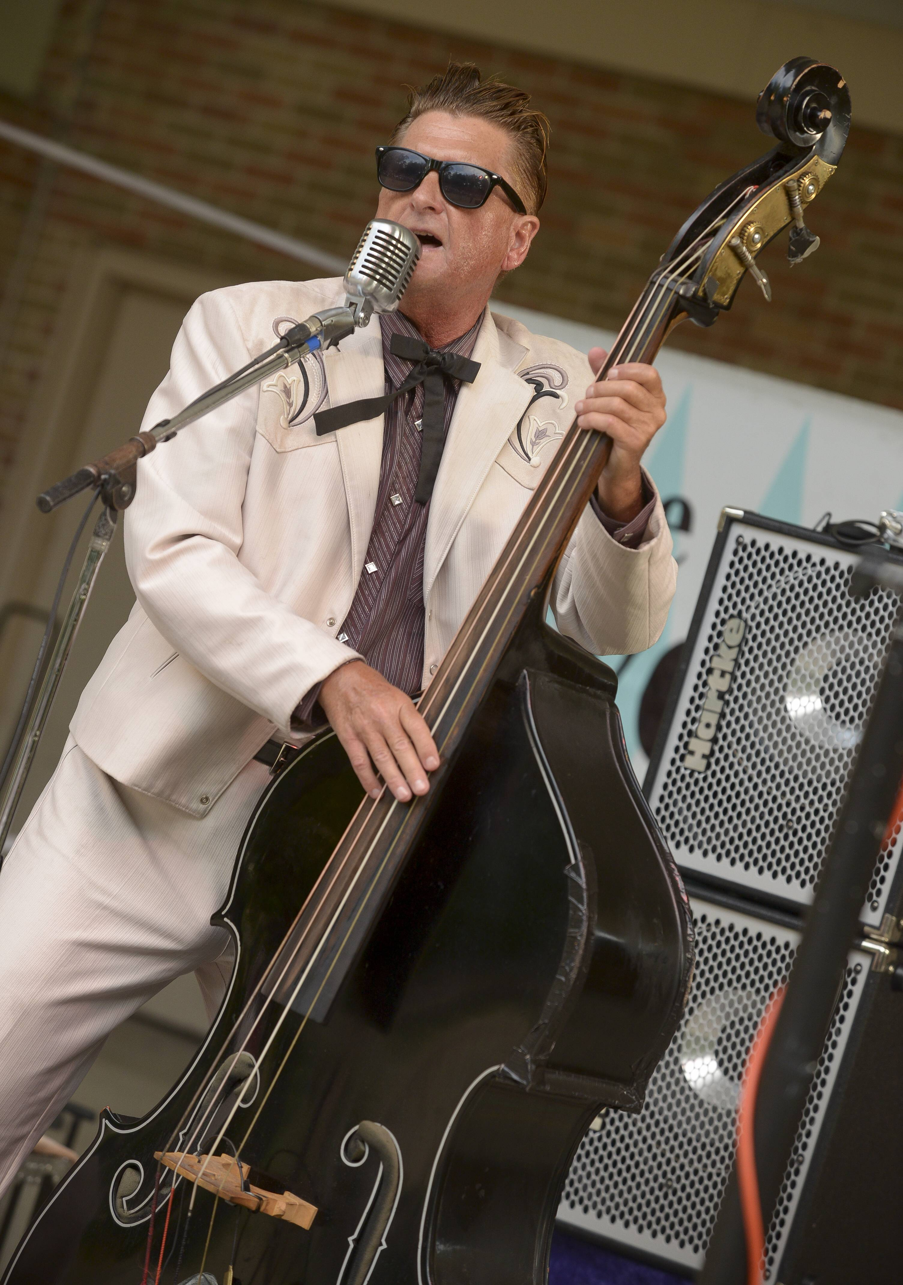Craig Gigstad plays the stand up bass while singing with The Neverly Brothers during a recent performance. The Neverly Brothers perform rock 'n' roll oldies, including songs from the Big Bopper, Buddy Holly, Roy Orbinson, Chuck Berry and Elvis. The band will perform at 4 p.m. Sunday at the Kane County Fair in St. Charles.
