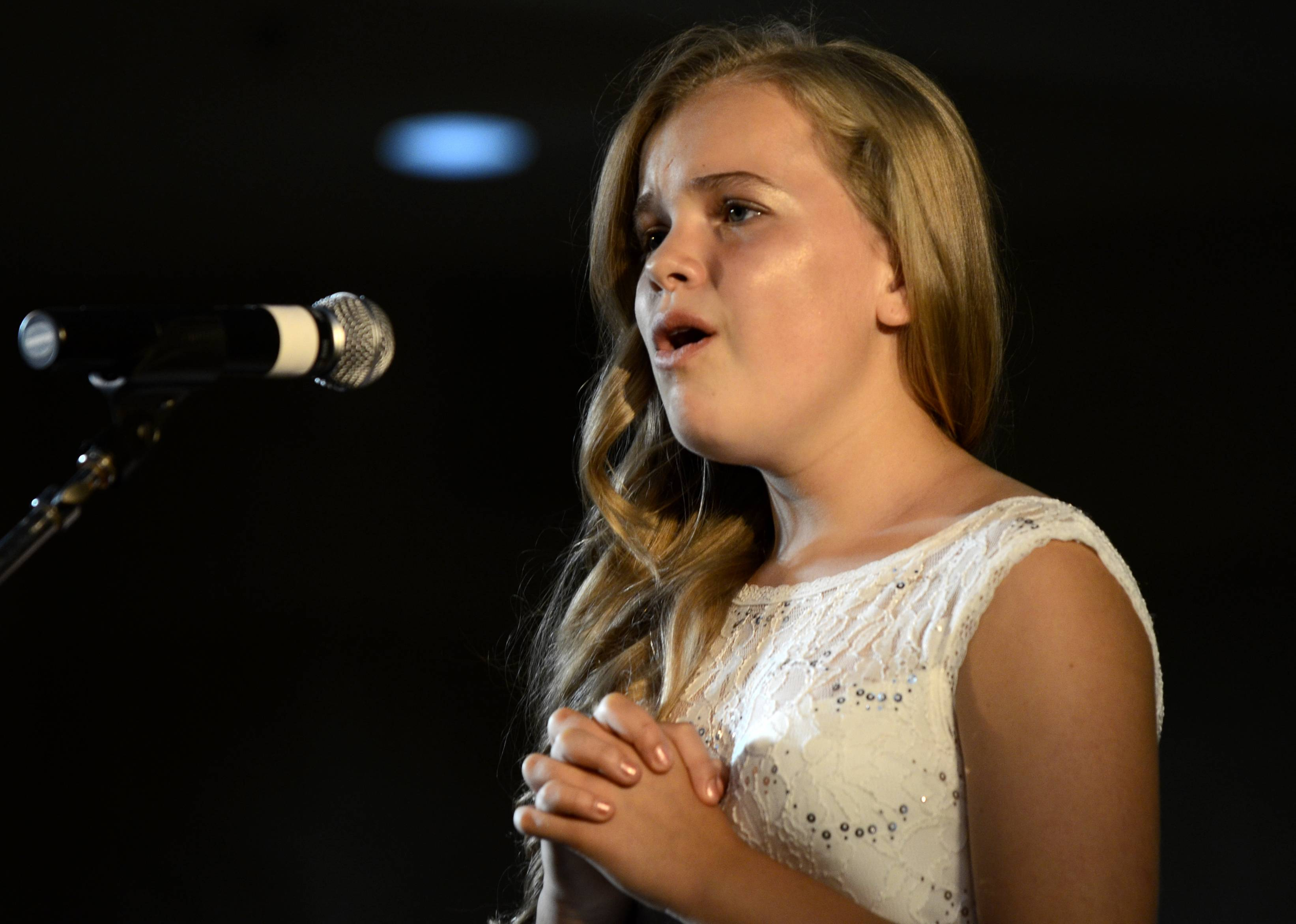 "Sophia Peterson, 12, of Elgin performs ""Ave Maria""on Monday at the Kane County Talent Show at Kane County Fairgrounds in St. Charles. Peterson finished first in the Junior Division and will move on to state competition in Springfield."