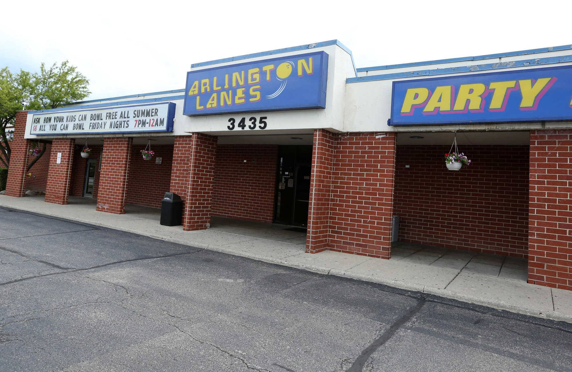 Arlington Heights village trustees voted this week to grant a new liquor license classification for Arlington Lanes, despite some concerns over measures the bowling alley's new owner says he might take to prevent underage patrons from obtaining alcohol.