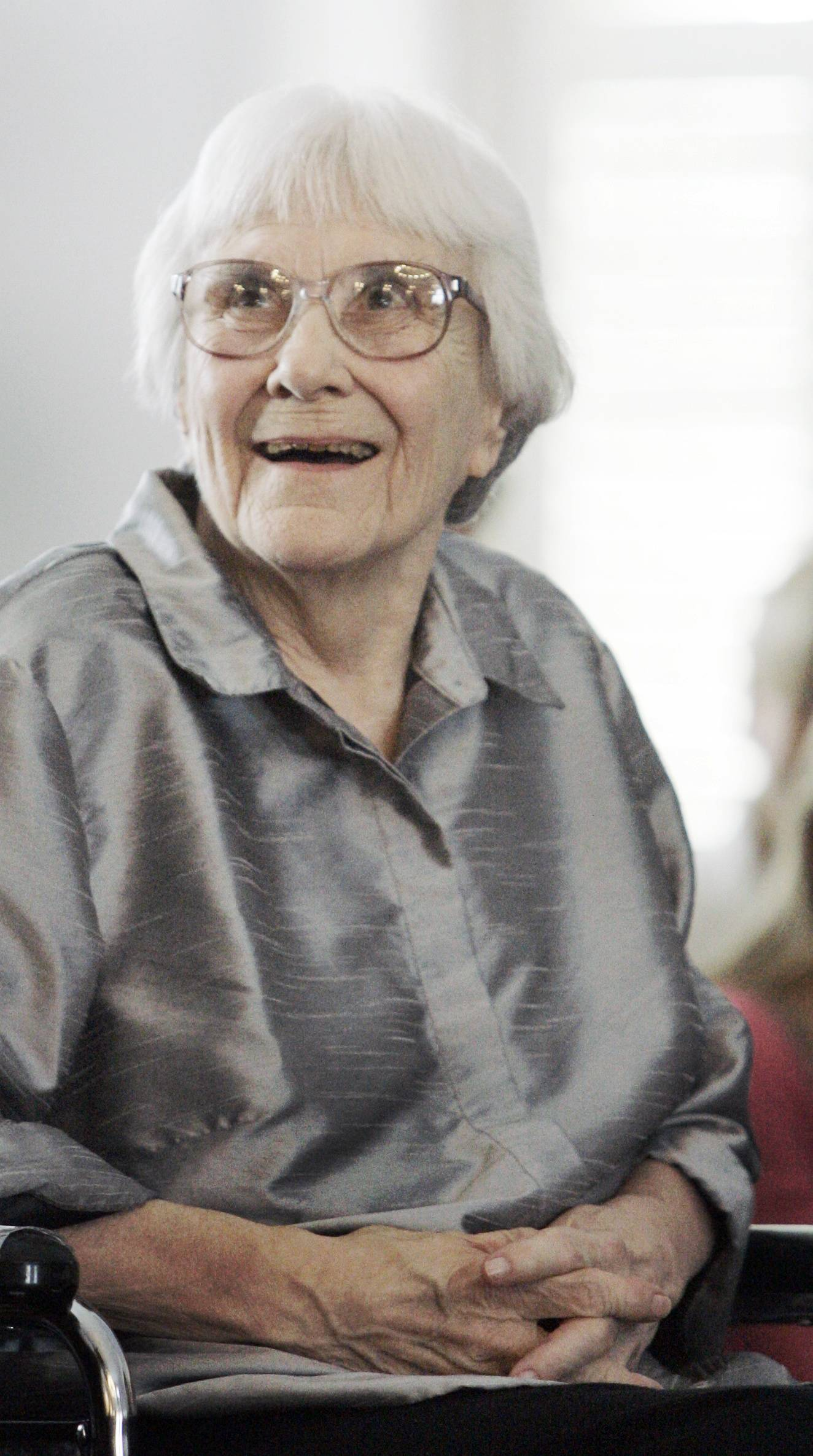 In this Aug. 20, 2007 photo, author Harper Lee smiles during a ceremony honoring the four new members of the Alabama Academy of Honor at the Capitol in Montgomery, Ala.