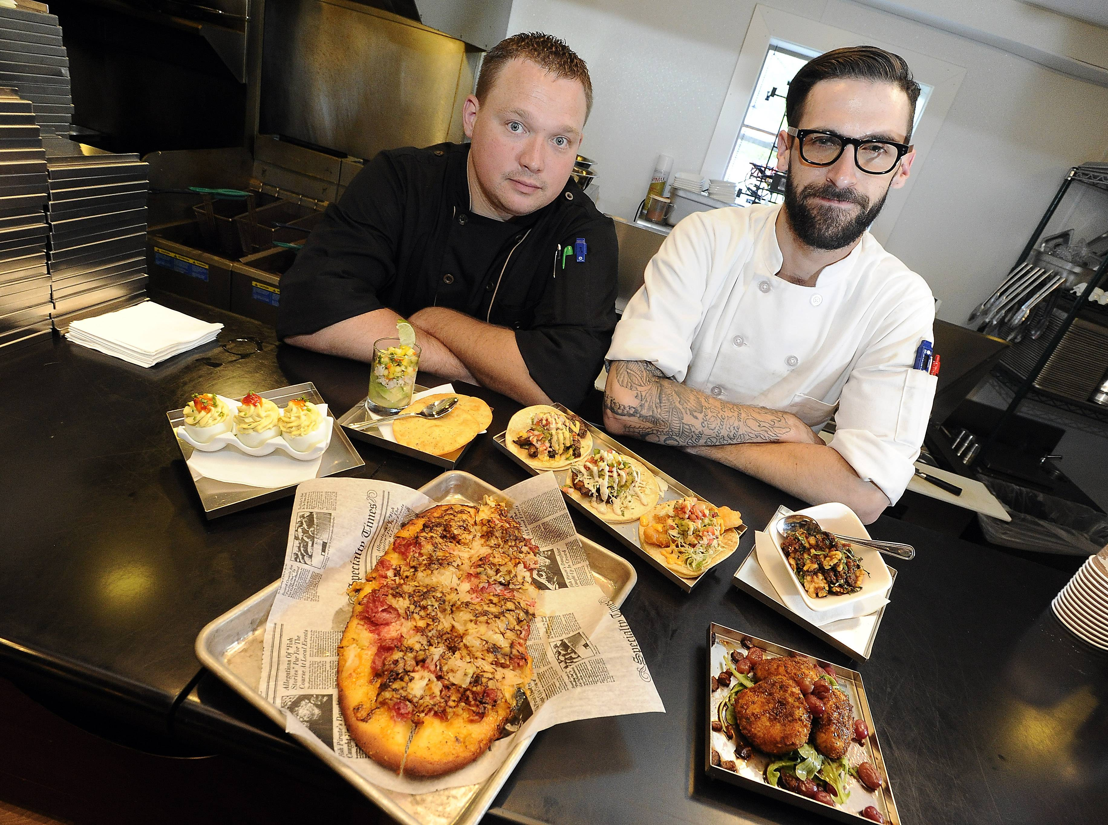 Executive Chef Christopher Rybicki and Sous Chef Matt Alfus prepare a variety of small plates at the Chatterbox of Long Grove.