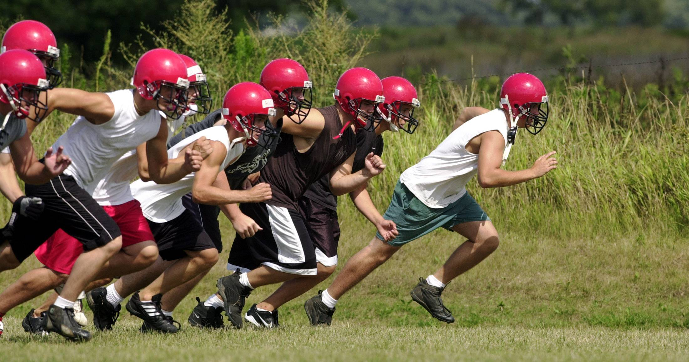 The first day of football practice for suburban high school teams is Aug. 11. But many young athletes play in summer leagues and camps, participate in strengthening and conditioning programs and dedicate themselves to one sport year round. Experts say that leads to injuries and burnout.