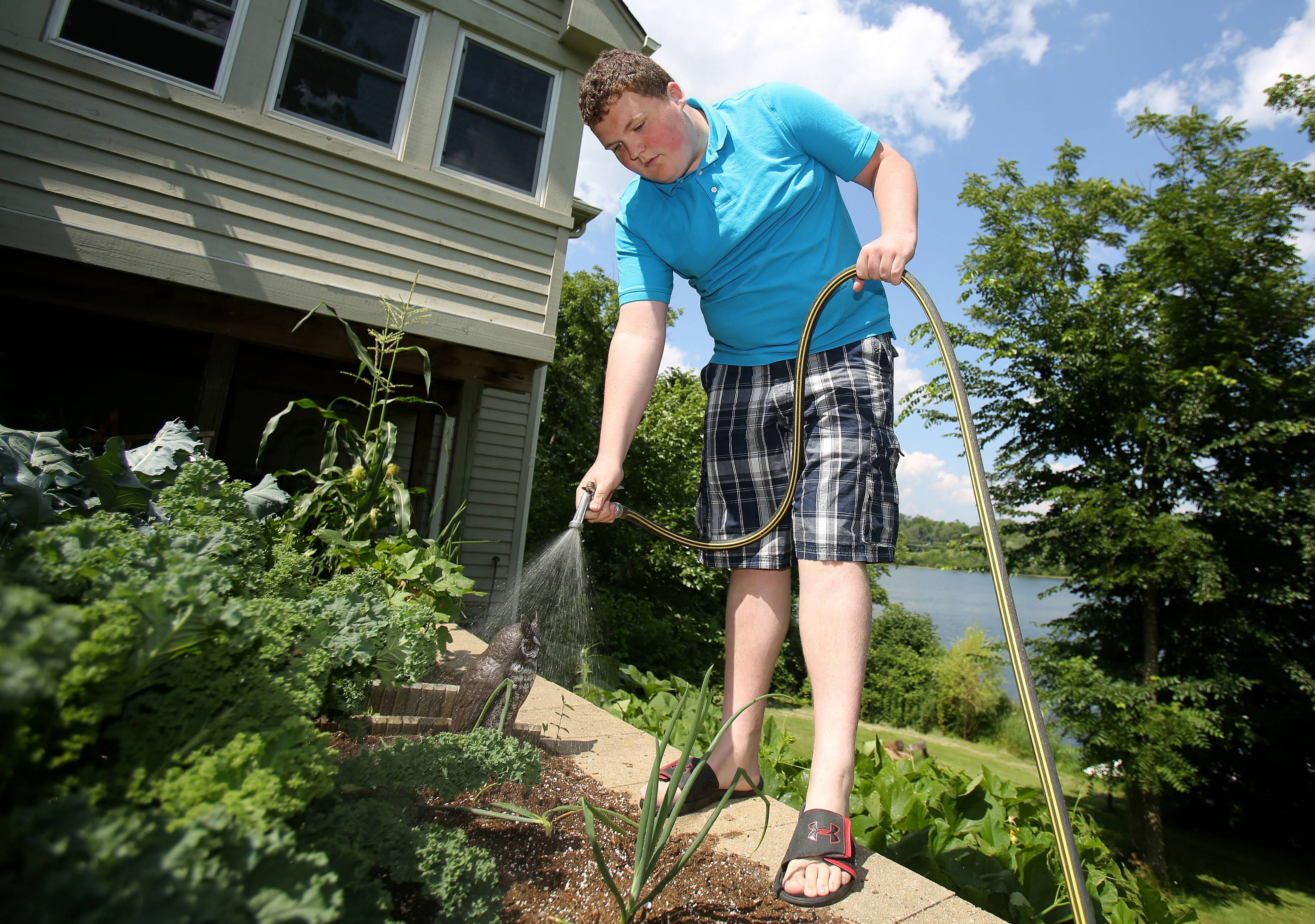 Sixteen-year-old Max McKeough, who has Asperger's syndrome, works on his vegetable garden a his home in Antioch. He just graduated from Antioch Community High School and gives talks about Asperger's to groups of parents and educators.