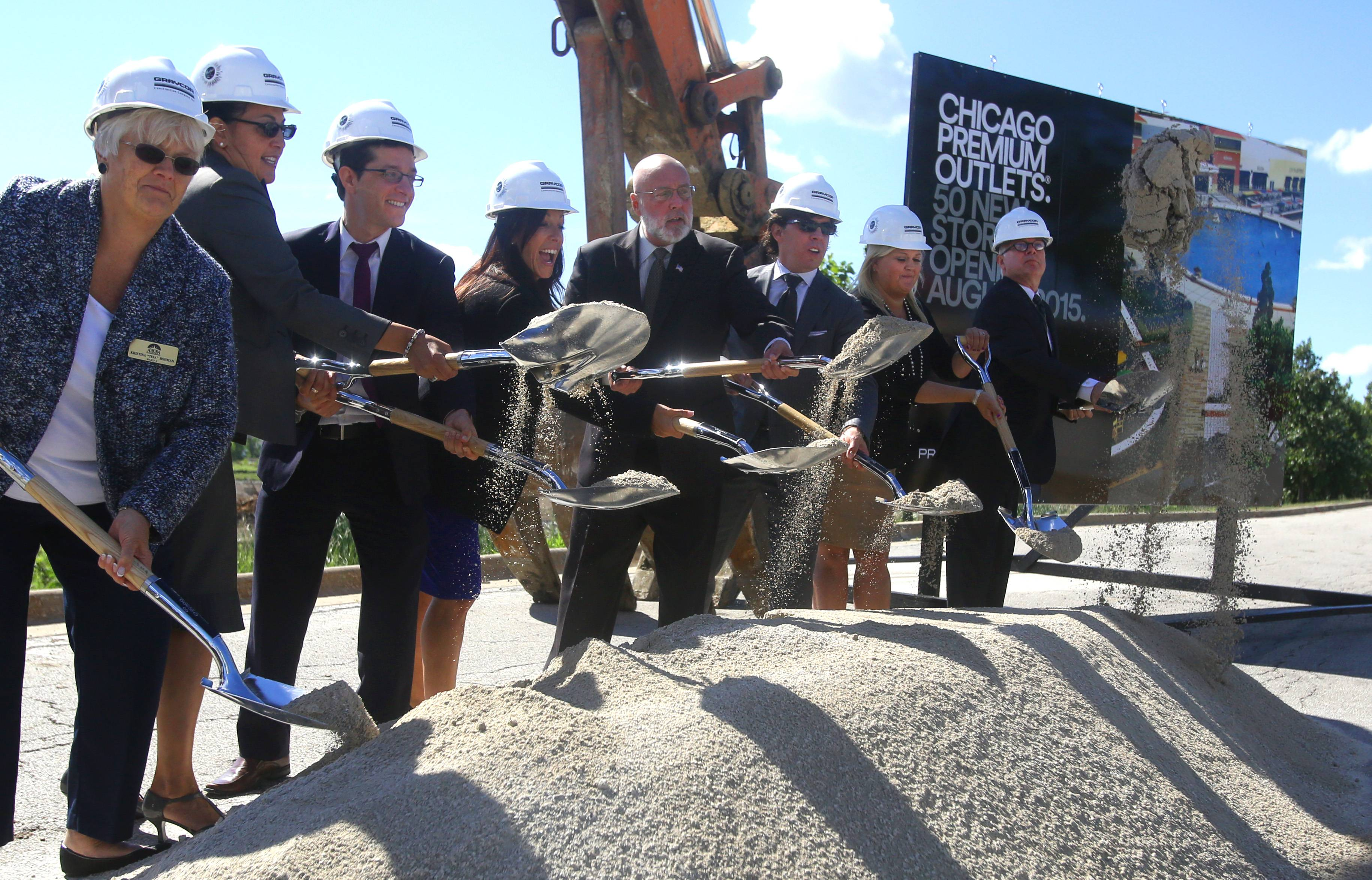 Aurora Mayor Tom Weisner, center, without hard hat, leads a groundbreaking ceremony Wednesday for a 50-store expansion of Chicago Premium Outlets at I-88 and Farnsworth Road.