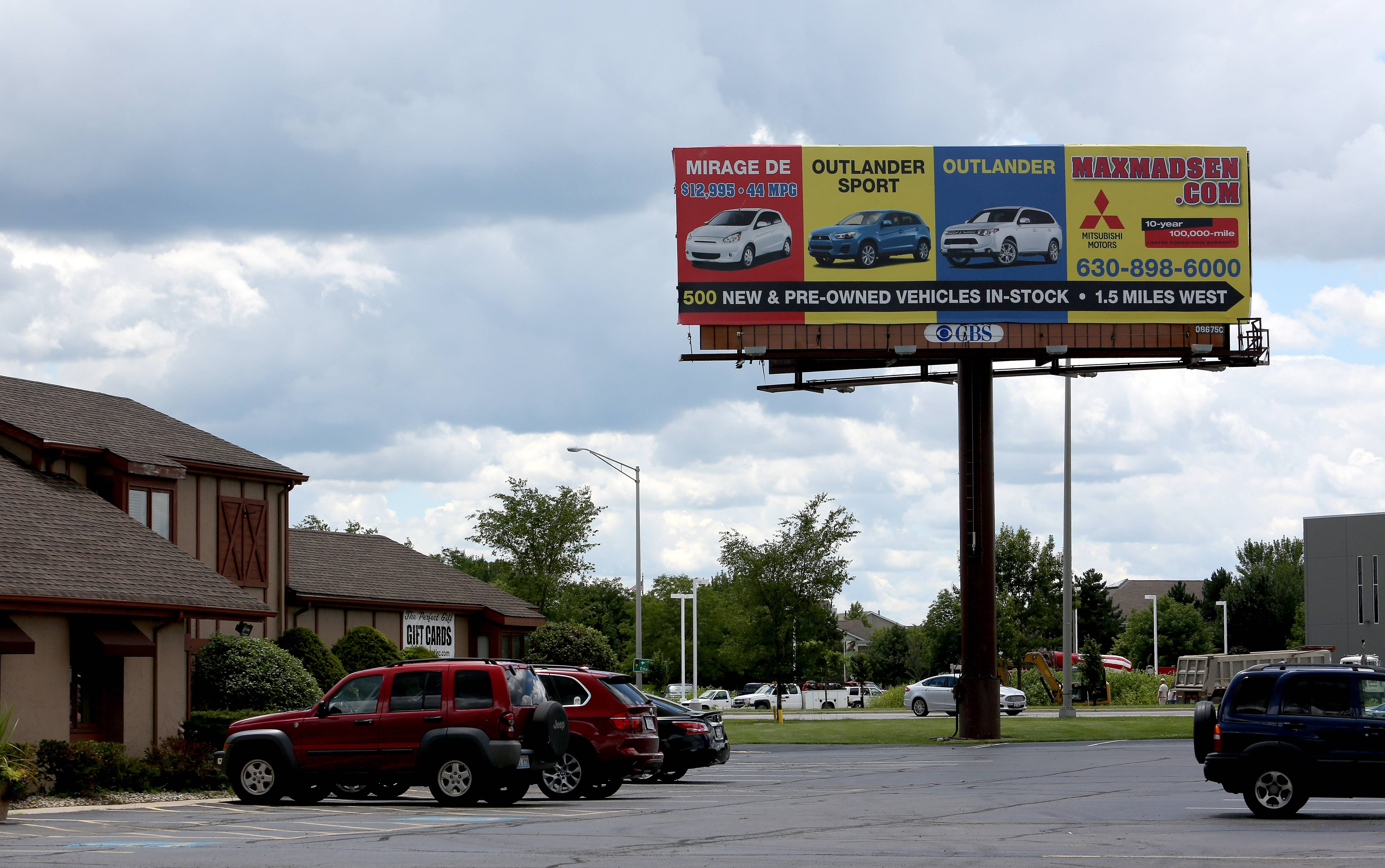 Naperville has agreed to allow billboards on Ogden Avenue at Rickert Drive to remain in place until Dec. 31, 2015.