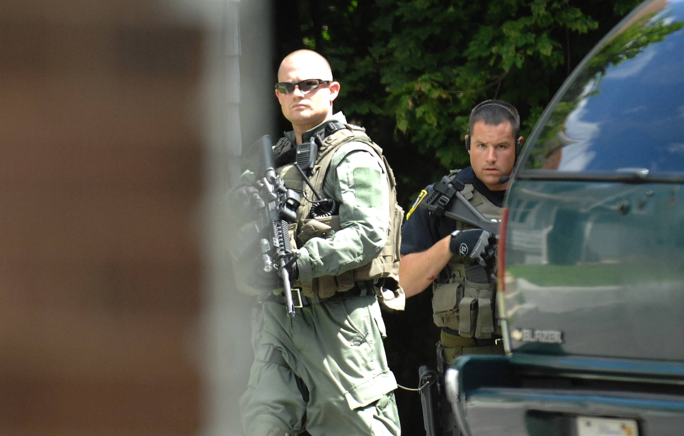 Elgin Police search a residential area on Seneca Street Wednesday looking for Jesse Vega.