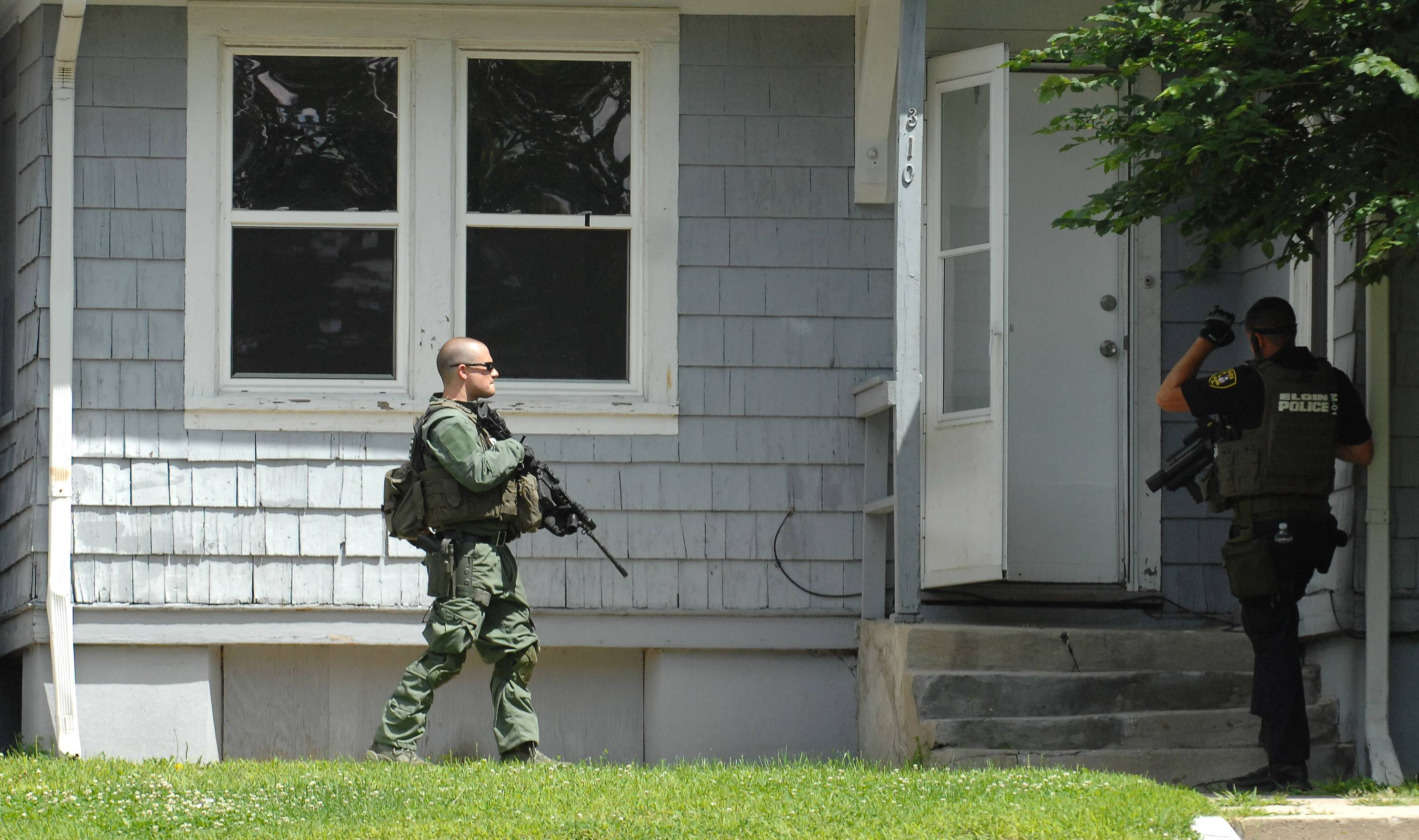 Elgin Police search a home off Seneca Street for Jesse Vega, a prisoner who escaped Elgin Mental Health Center authorities Wednesday morning.