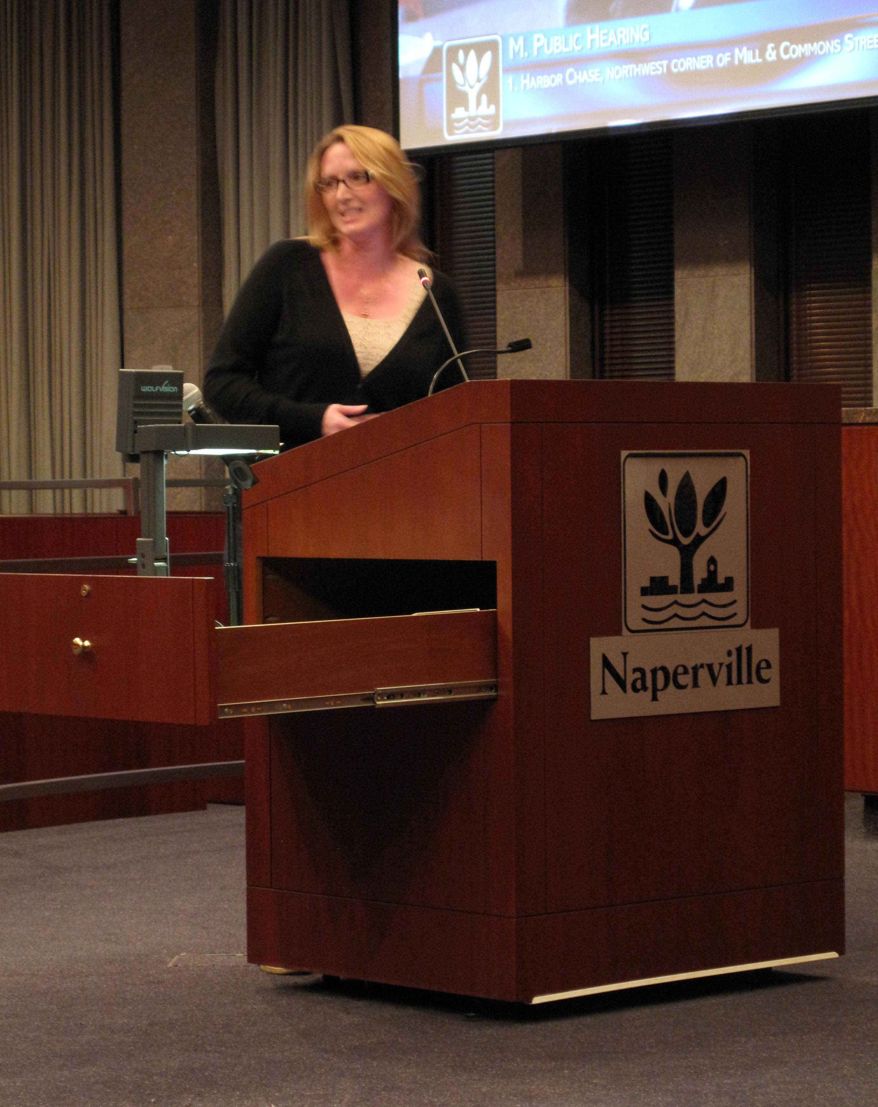 Fran Bixler, president of the homeowners' association for the Century Farms subdivision, discusses concerns about traffic near an assisted living center the Naperville City Council approved Tuesday to be built east of her neighborhood.