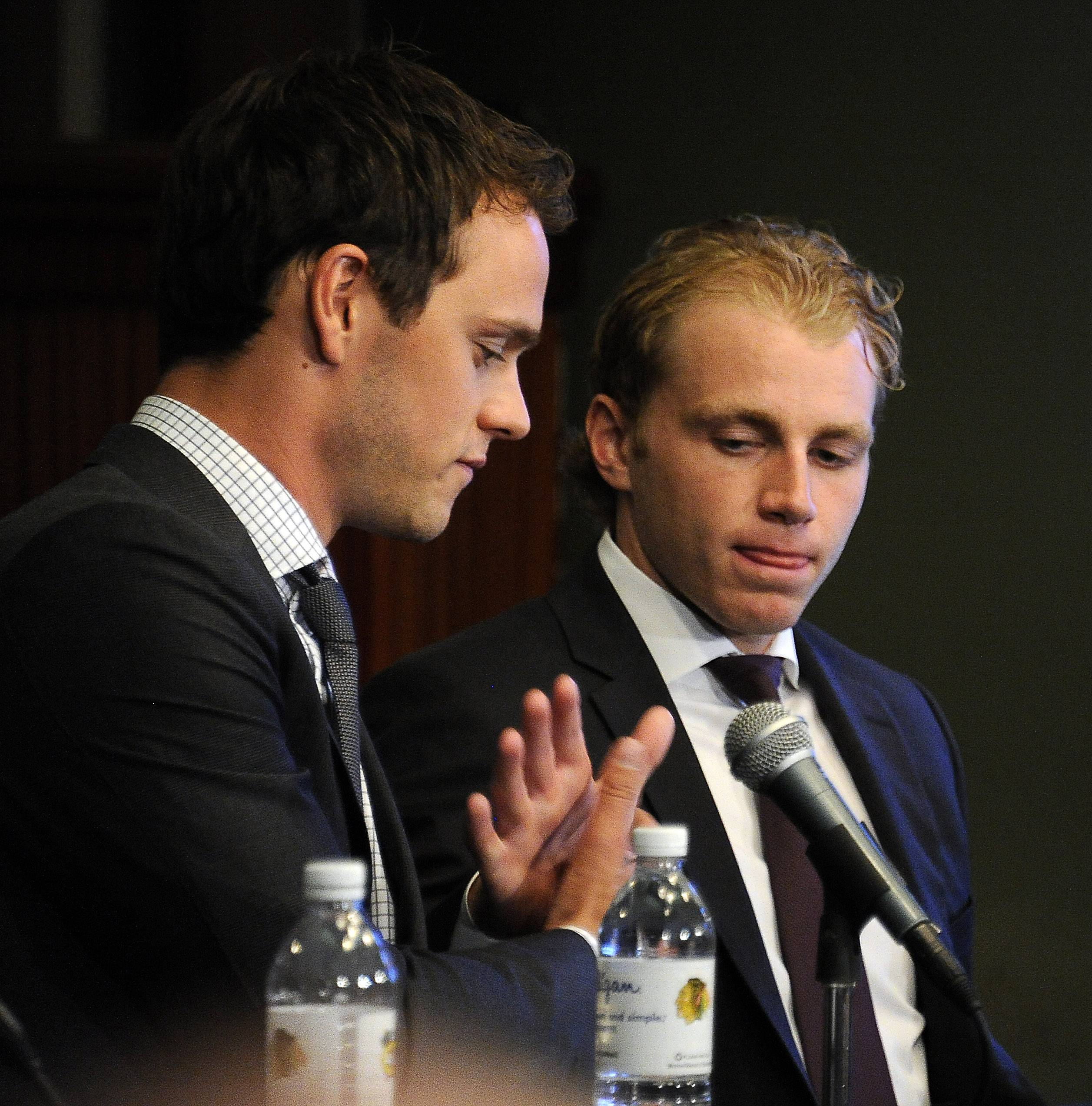 Blackhawks captain Jonathan Toews, left, and Patrick Kane shake hands after talking at their news conference Wednesday at the United Center. The iconic pair recently agreed to identical eight-year contract extensions.