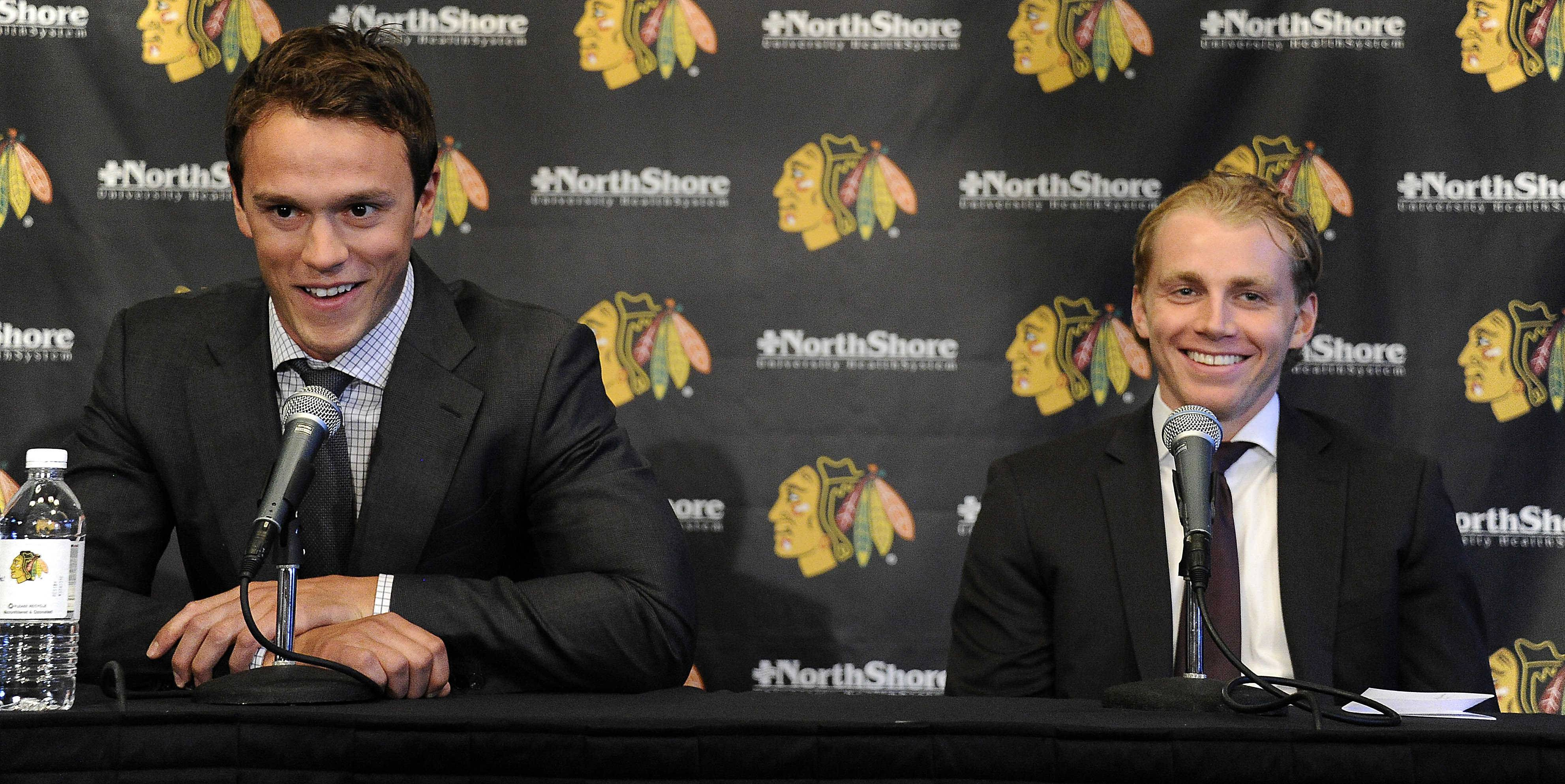 Blackhawks teammates Jonathan Toews, left, and Patrick Kane smile during a news conference at the United Center on Wednesday.