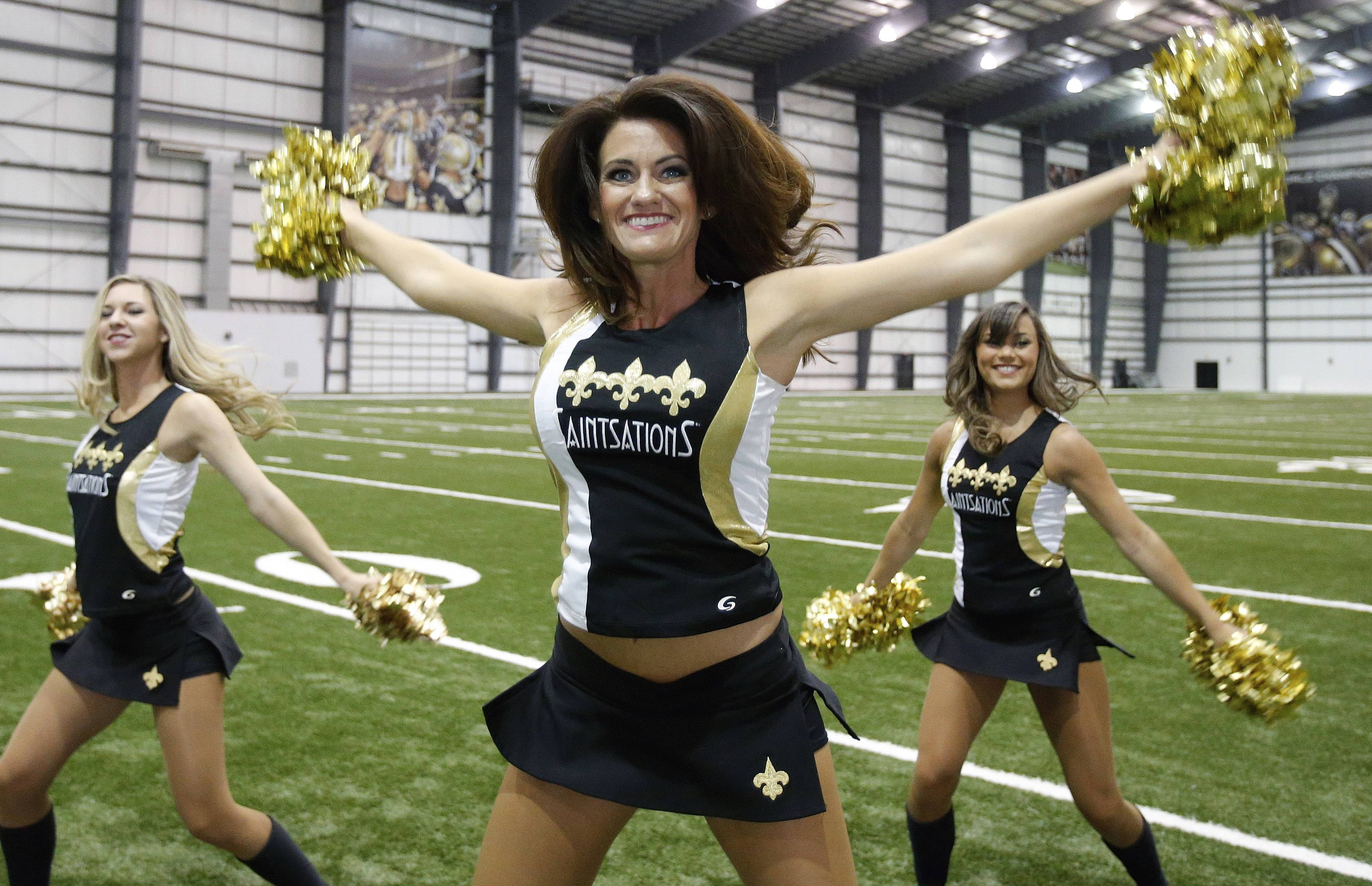 New Orleans Saints Saintsation Kriste Lewis performs during a photo shoot at the NFL football team's training facility in Metairie, La., Wednesday, July 16, 2014. Lewis is one of only two NFL cheerleaders in her 40s. The other dancer is 45-year-old Laura Vikmanis, who has been with the Cincinnati Bengals dance team, the Ben-Gals, since making the squad at age 40.