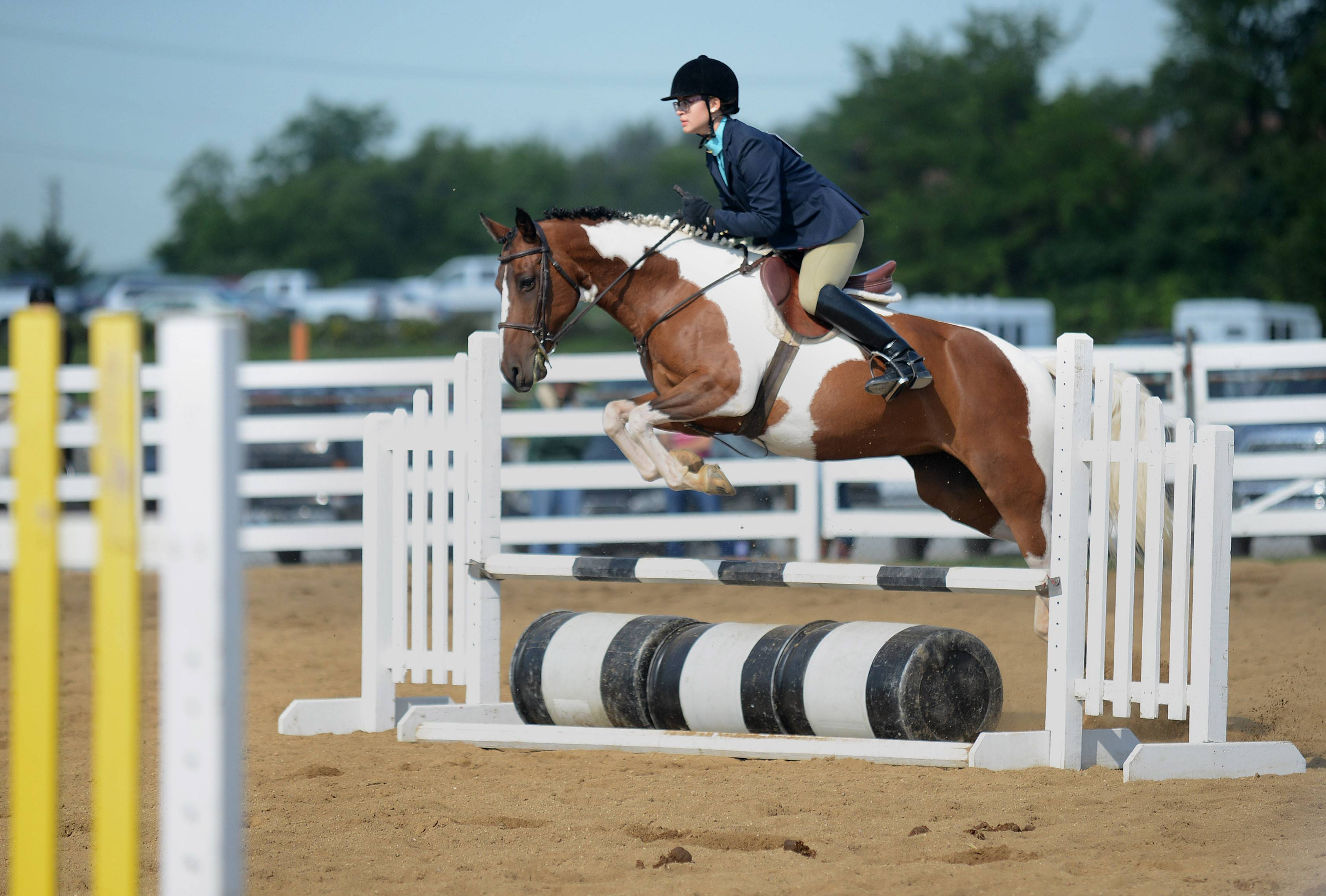 Madde Klinkey, 15, of Wasco, and her horse, Coco, compete in jumping Thursday morning at the Kane County Fair in St. Charles. She is a member of the A Bit More 4-H Club. Coco's full name is Shimmy Shimmy Coco Pop.