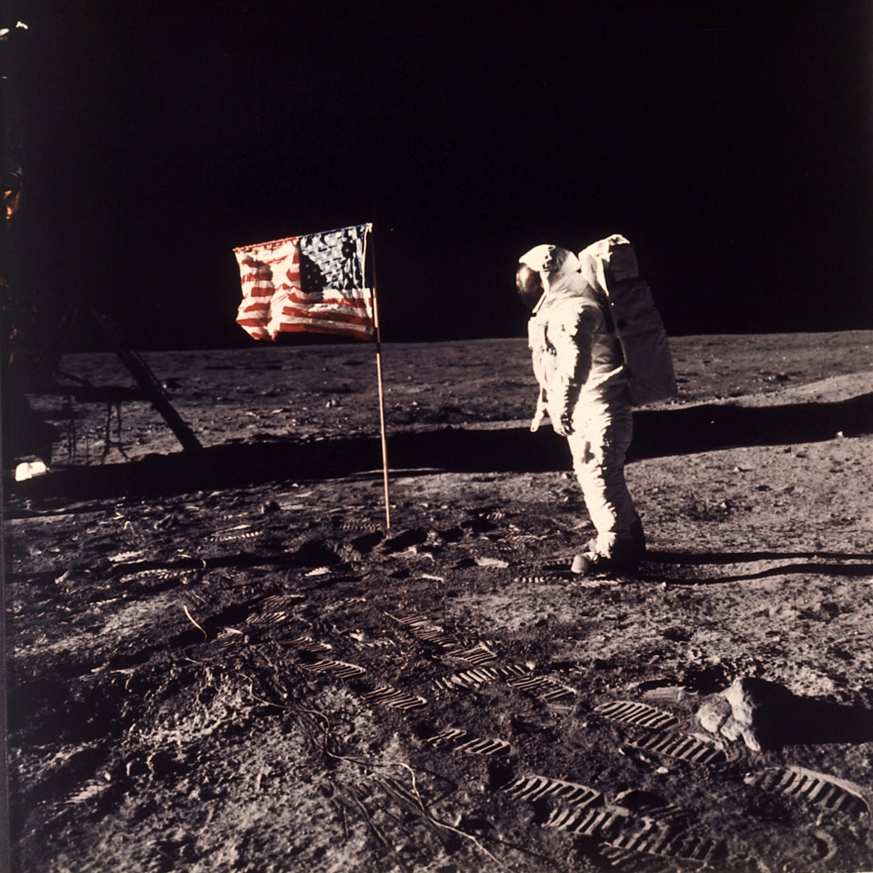"ASSOCIATED PRESS/NASA Astronaut Edwin E. ""Buzz"" Aldrin Jr. stands beside a U.S. flag deployed on the moon during the Apollo 11 mission on July 20, 1969. Aldrin and fellow astronaut Neil Armstrong were the first men to walk on the lunar surface."