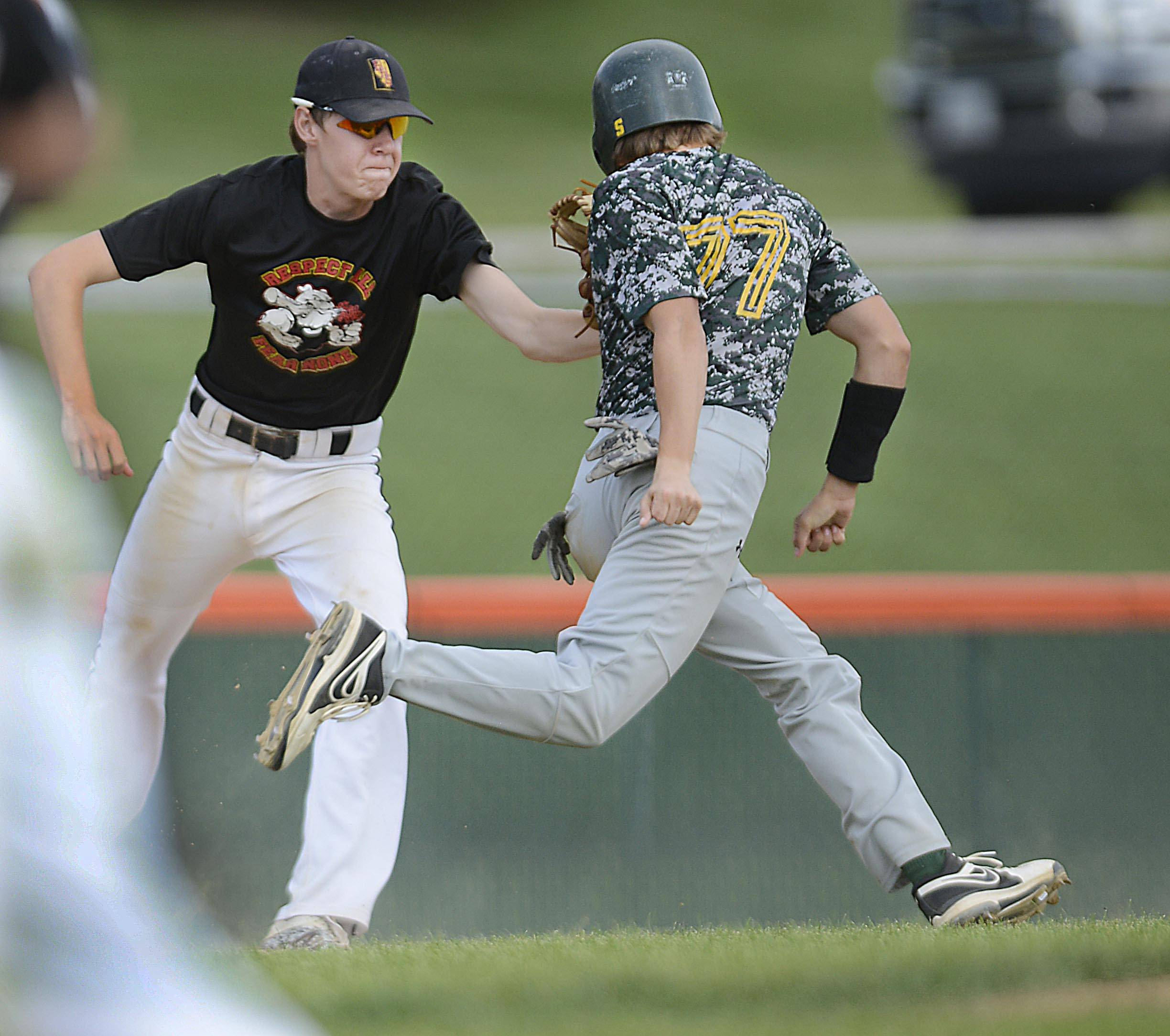 Batavia shortstop Sean Townsend tags out Chrystal Lake's Cam Geisser in a rundown between third base and home in the championship of the St. Charles East regional.