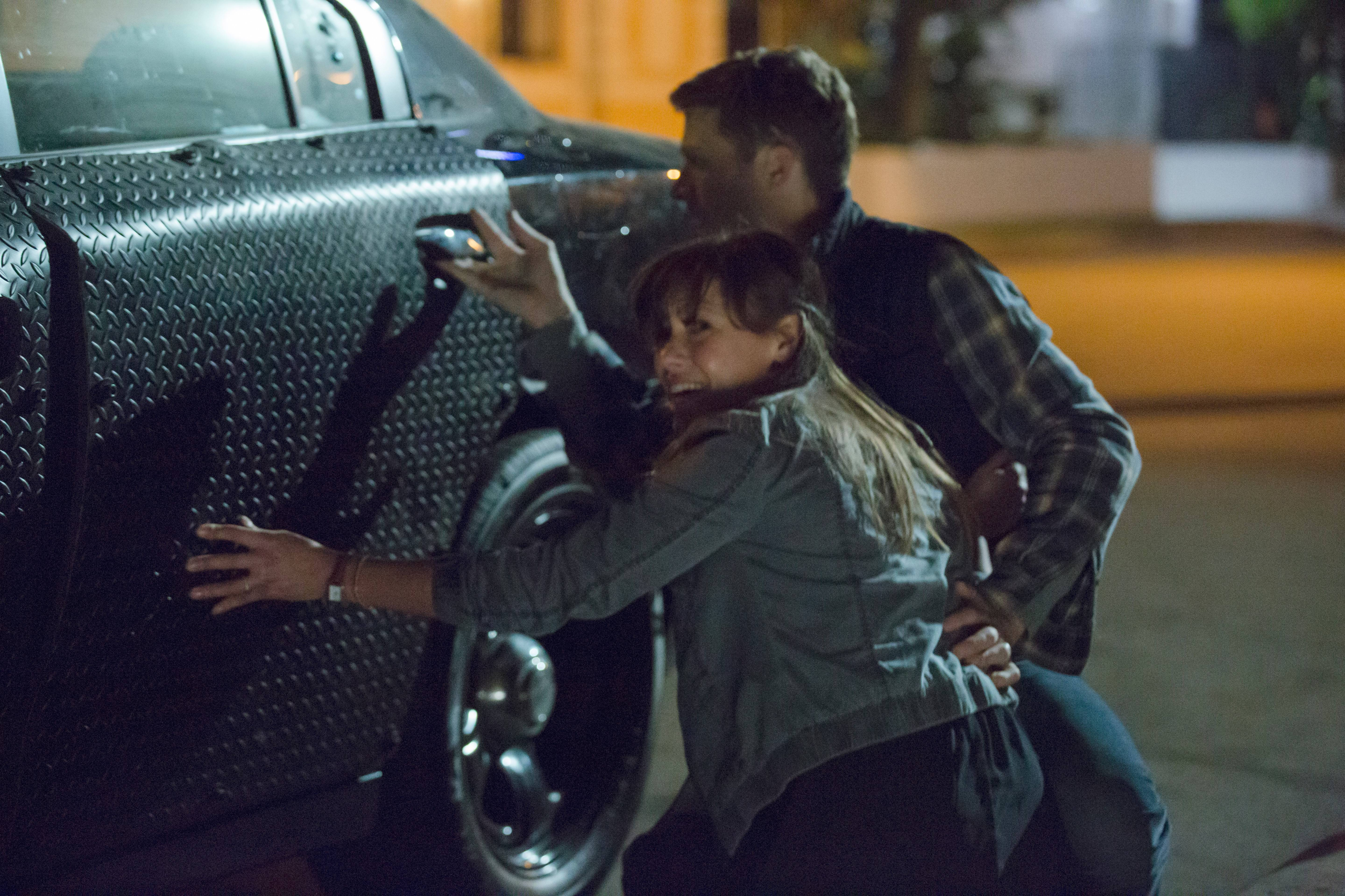 "Liz (Kiele Sanchez) and husband Shane (Zach Gilford) try to survive the night in ""The Purge: Anarchy."""