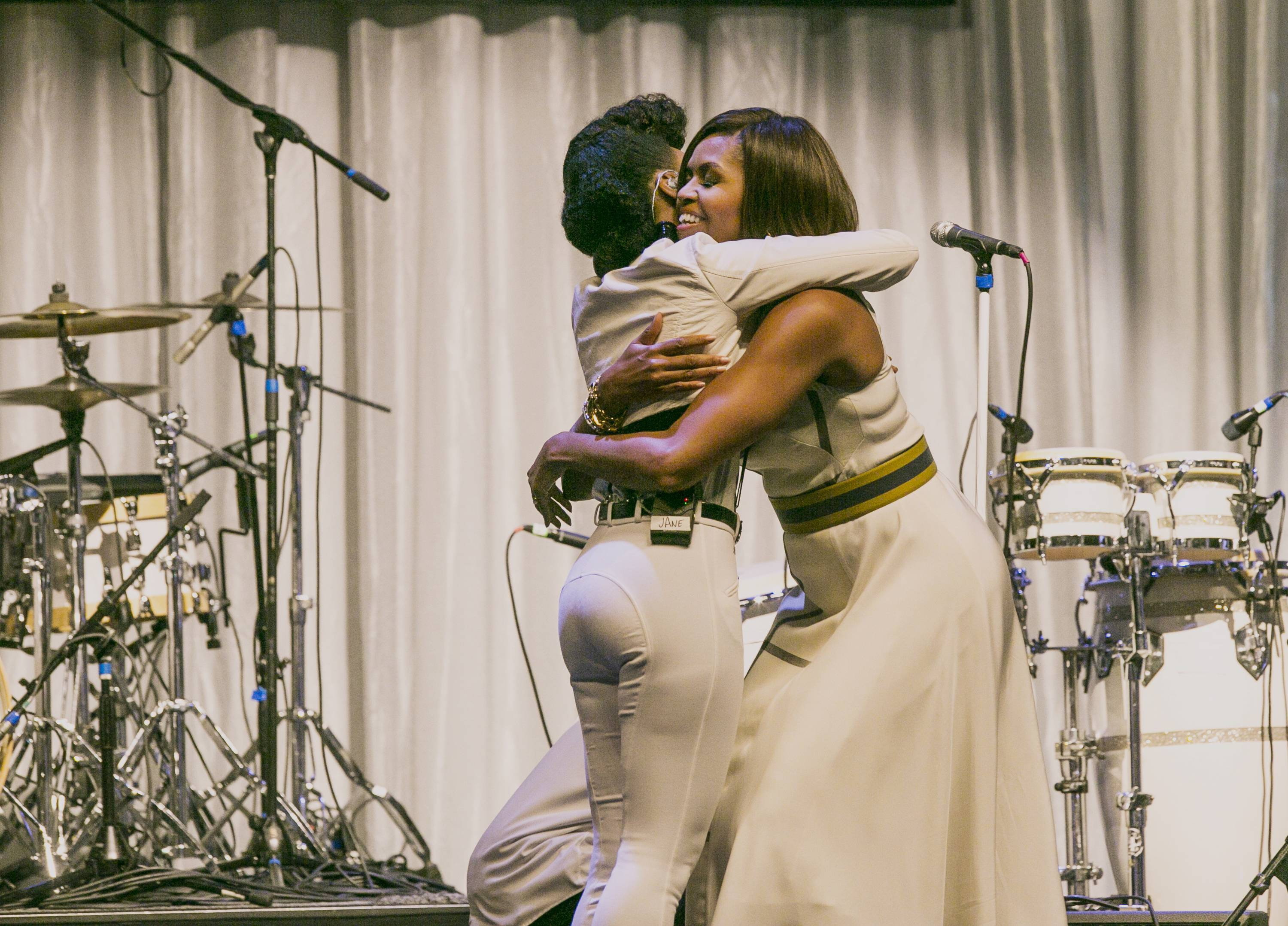 First lady Michelle Obama hugs Janelle Monae, a Grammy Award-nominated singer after delivering remarks at the Grammy Museum's Jane Ortner Education Award Luncheon in Los Angeles Wednesday, July, 16, 2014. The first lady says every arts organization in the country should embrace the mission of the Grammy Museum in Los Angeles, which focuses on education.