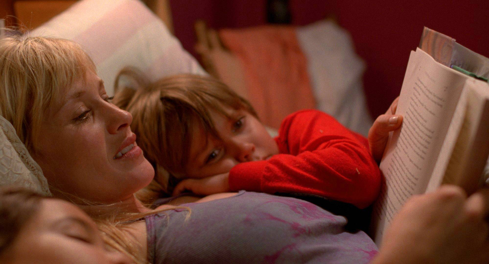 "Single parent Olivia (Patricia Arquette) and her son Mason (Ellar Coltrane) struggle to survive in Richard Linklater's ""Boyhood."""