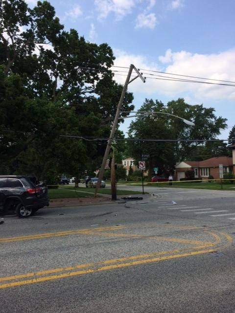 ComEd crews were working to fix an electric pole at Central Road and Emerson Street that was damaged during a two-vehicle crash in Mount Prospect on Thursday. Two people were hurt in the crash, which also left about 400 people without power for five hours.