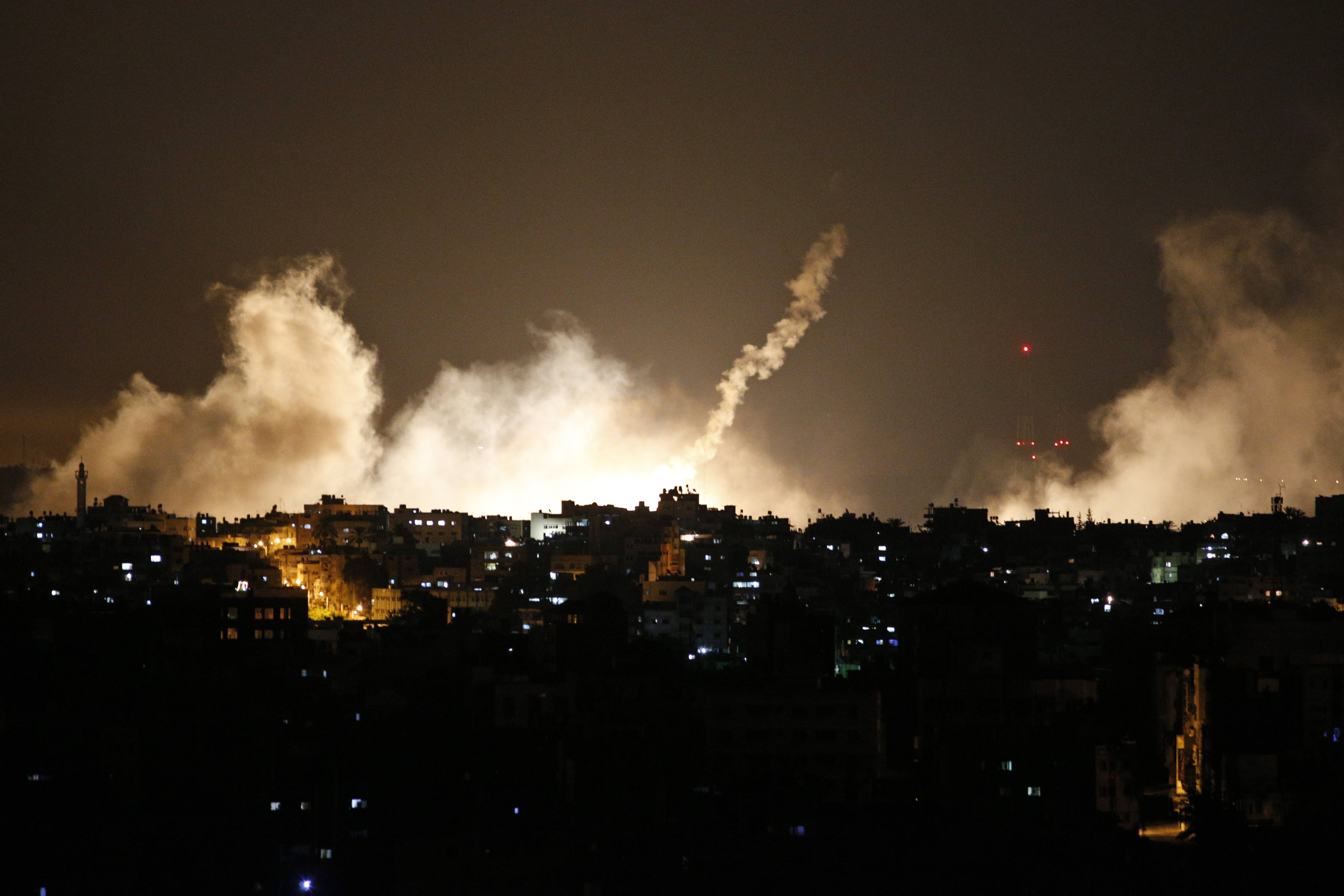 Smoke from flares rises in the sky in Gaza City, in the northern Gaza Strip, Thursday, when Israel launched a large-scale ground offensive, escalating a 10-day military operation to try to destroy Hamas' weapons arsenal, rocket firing abilities and tunnels under the Palestinian territory's border with Israel. It was the first major Israeli ground offensive in Gaza in just over five years.