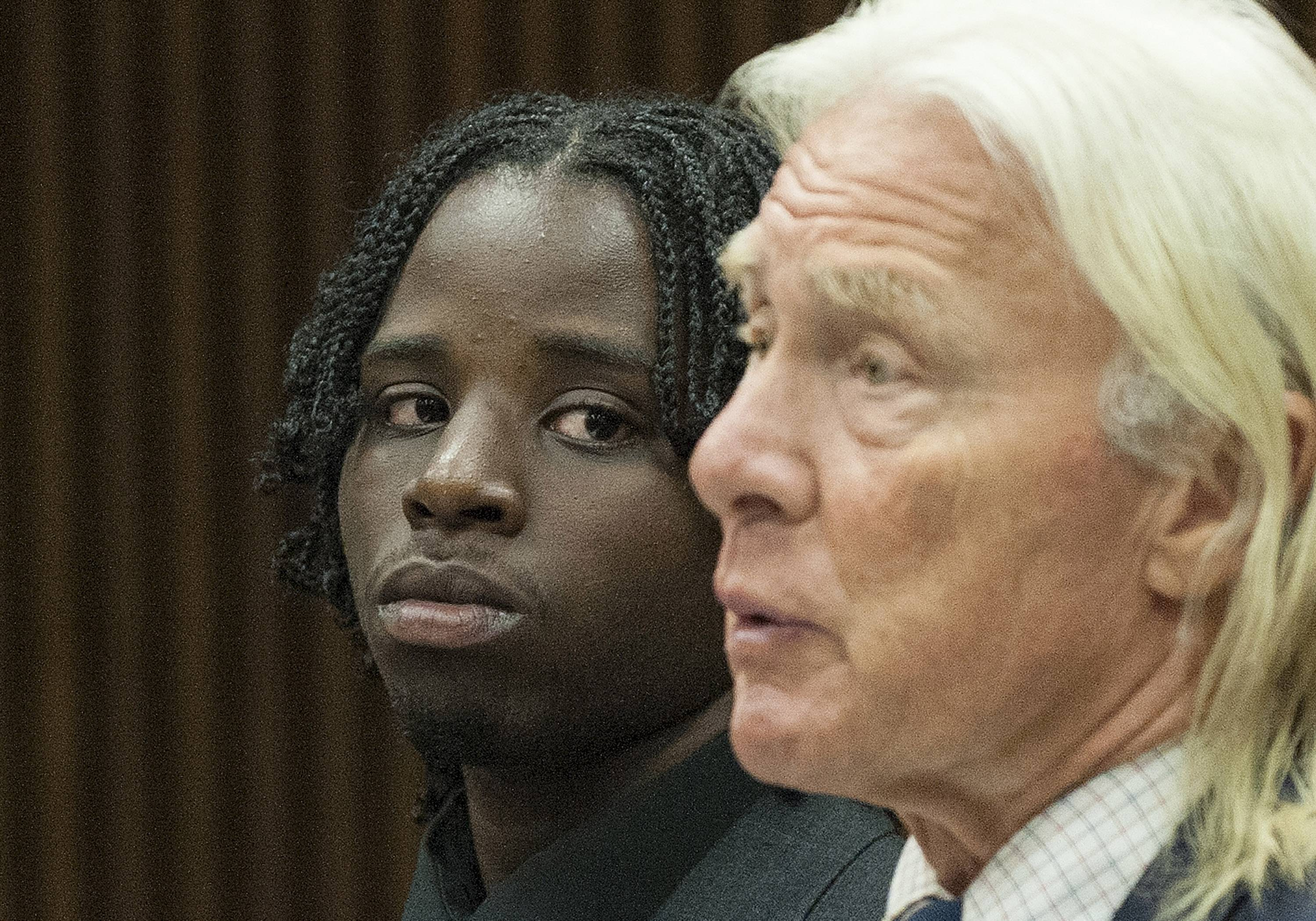 Latrez Cummings, left, stands with his attorney Robert Slameka in a Detroit court.