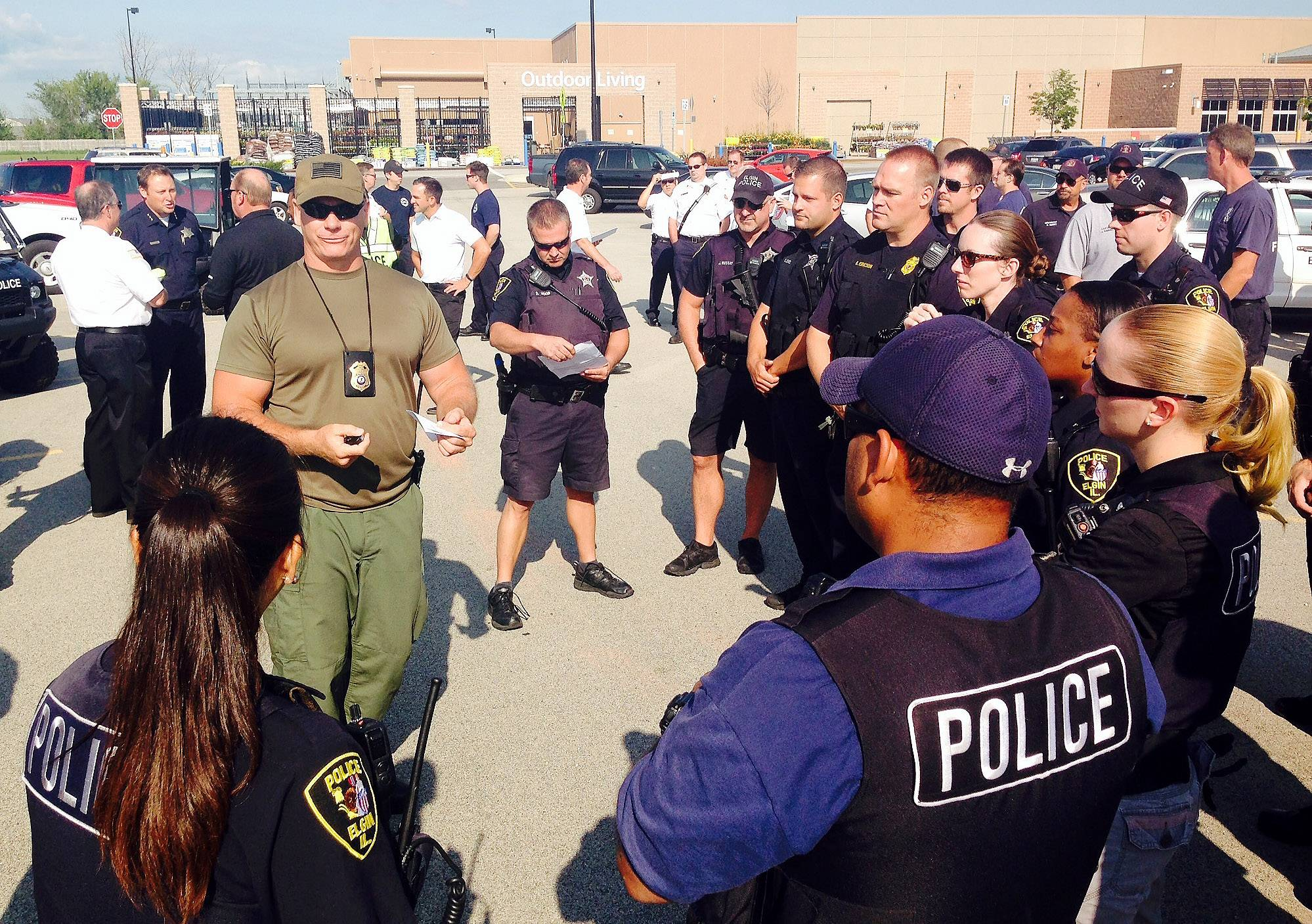 Elgin Police Lt. Colin Fleury briefs emergency responders Thursday in the parking lot of Wal-Mart on Randall and Bowes roads before a training exercise at nearby Otter Creek Elementary School.