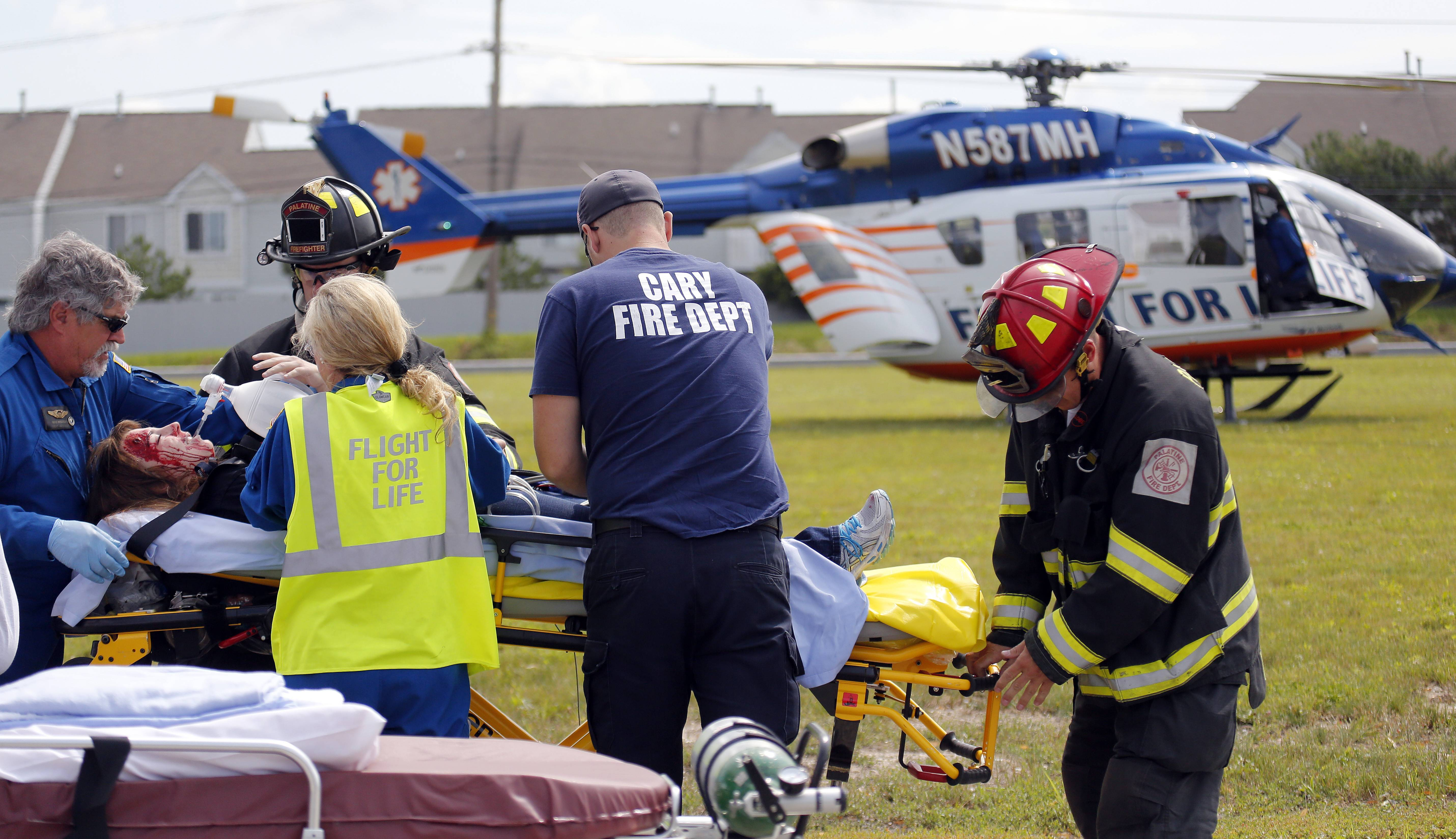 A patient is prepared for transport on a Flight for Life helicopter Thursday in front of Wal-Mart in Elgin during a training exercise conducted by the Elgin police and fire departments.