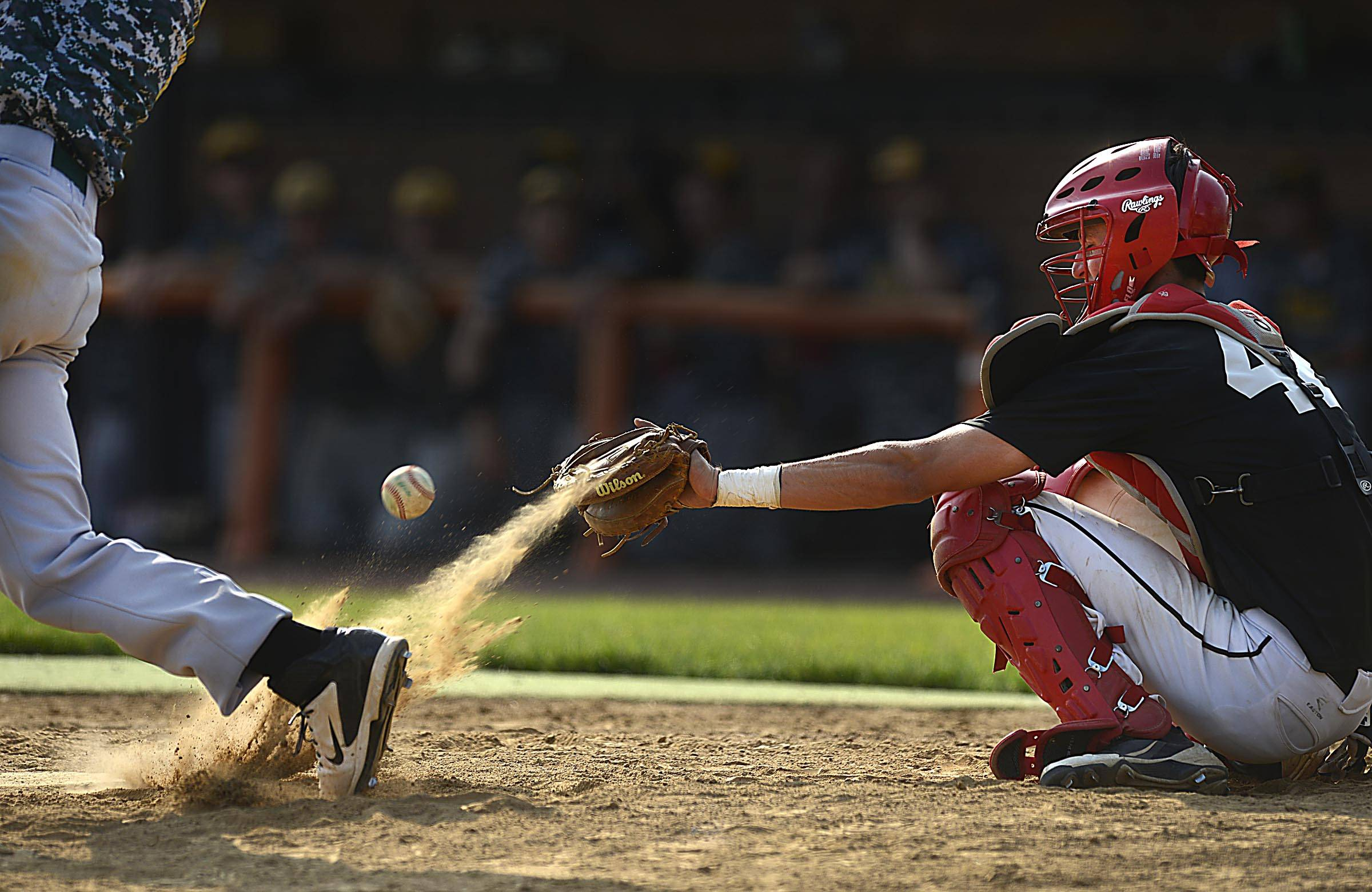 Batavia catcher Matt Musielak tries to glove a pitch in the dirt in the championship game of the St. Charles East regional state summer baseball tournament Thursday.