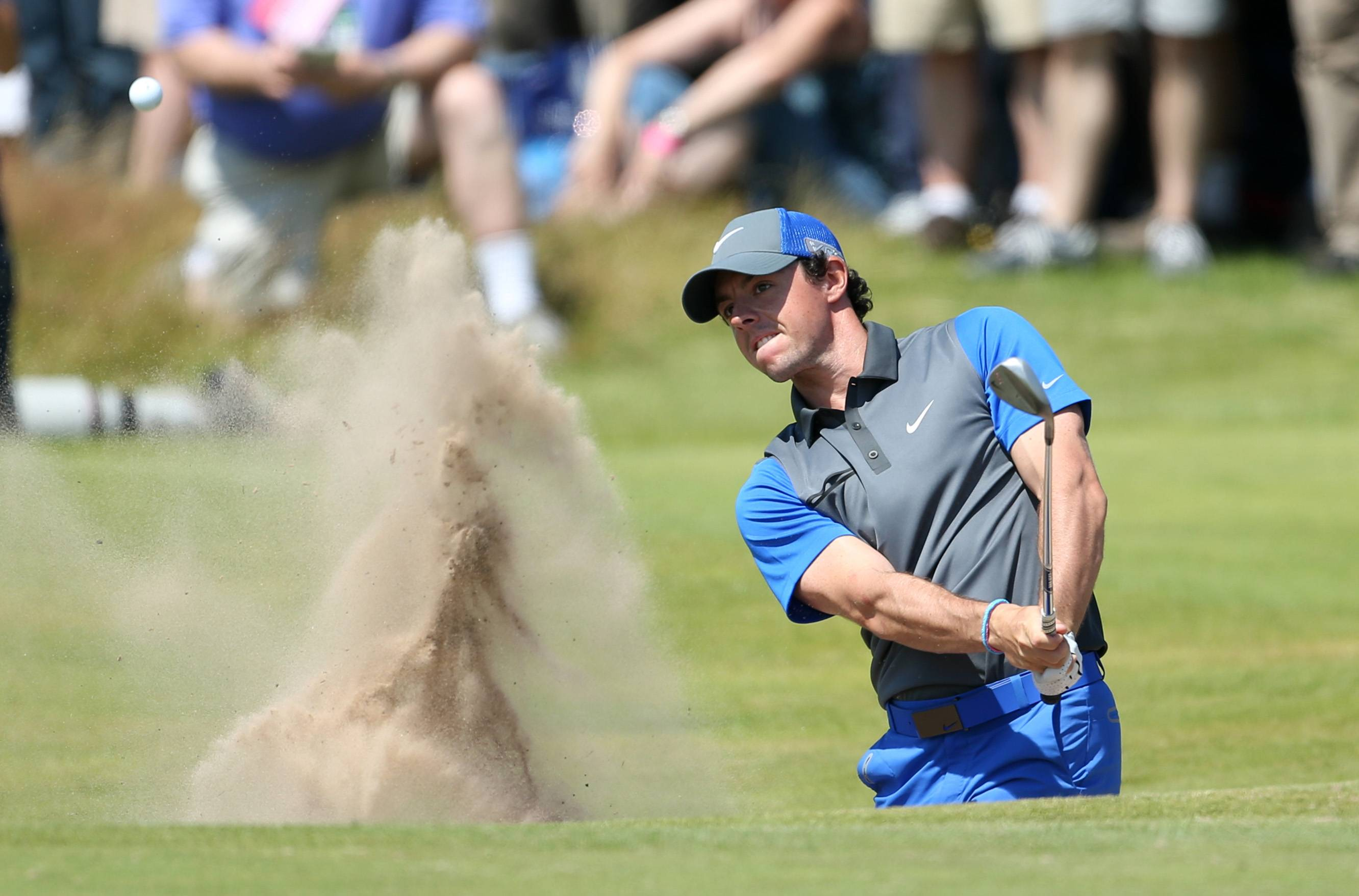 Rory McIlroy plays out of a bunker on the 16th hole Thursday during the first round of the British Open at the Royal Liverpool golf club.