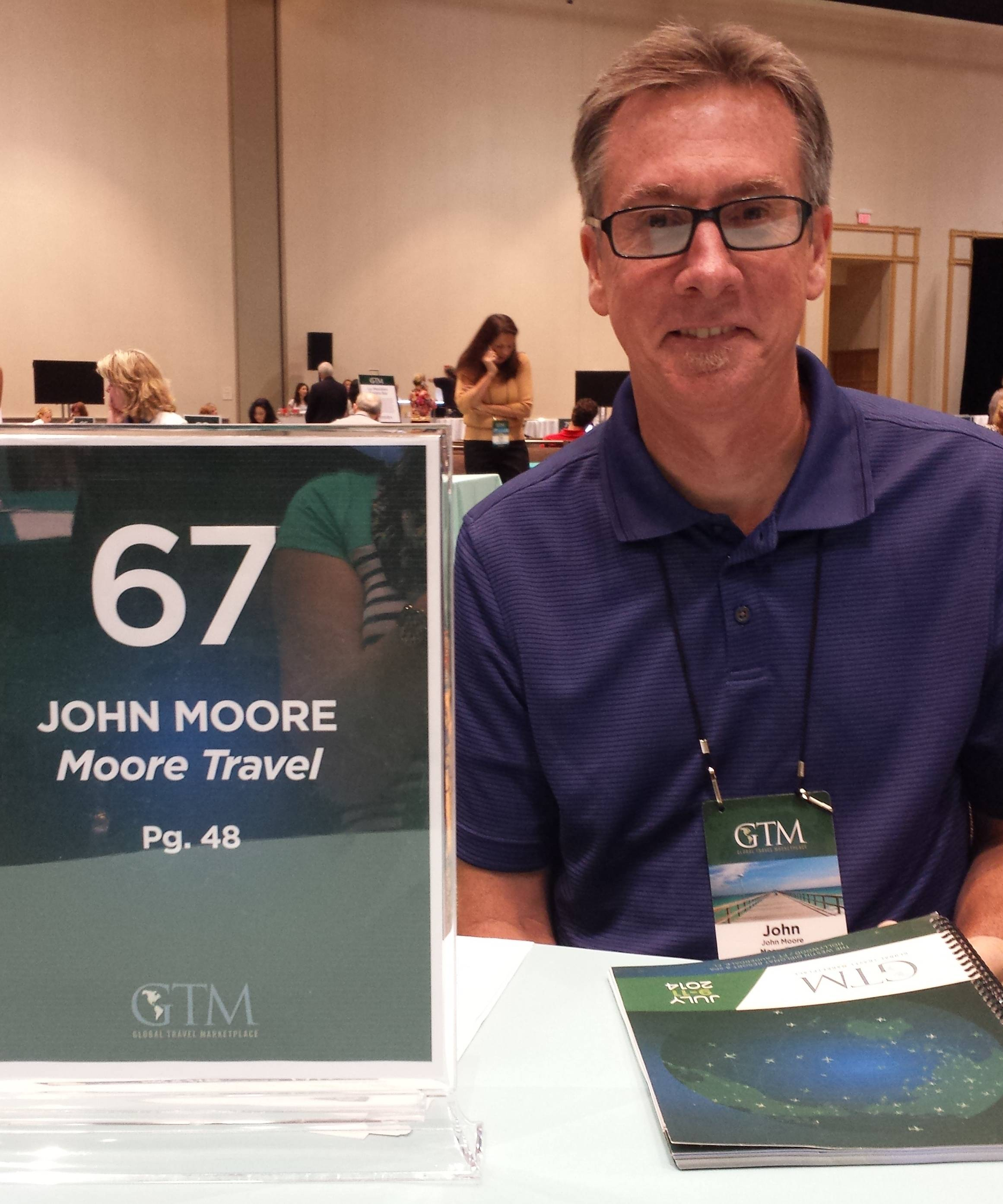 John Moore, Owner of Moore Travel in Bartlett conducts face to face business meetings at the elite Global Travel Marketplace held at Westin Diplomat Resort July 9-11, 2014Annette Moore