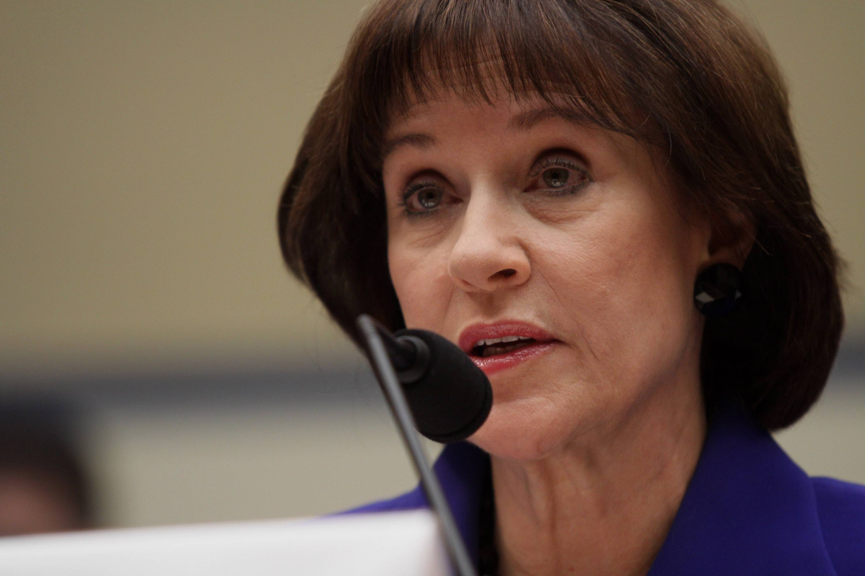 Former Internal Revenue Service official Lois Lerner speaks on Capitol Hill in Washington.
