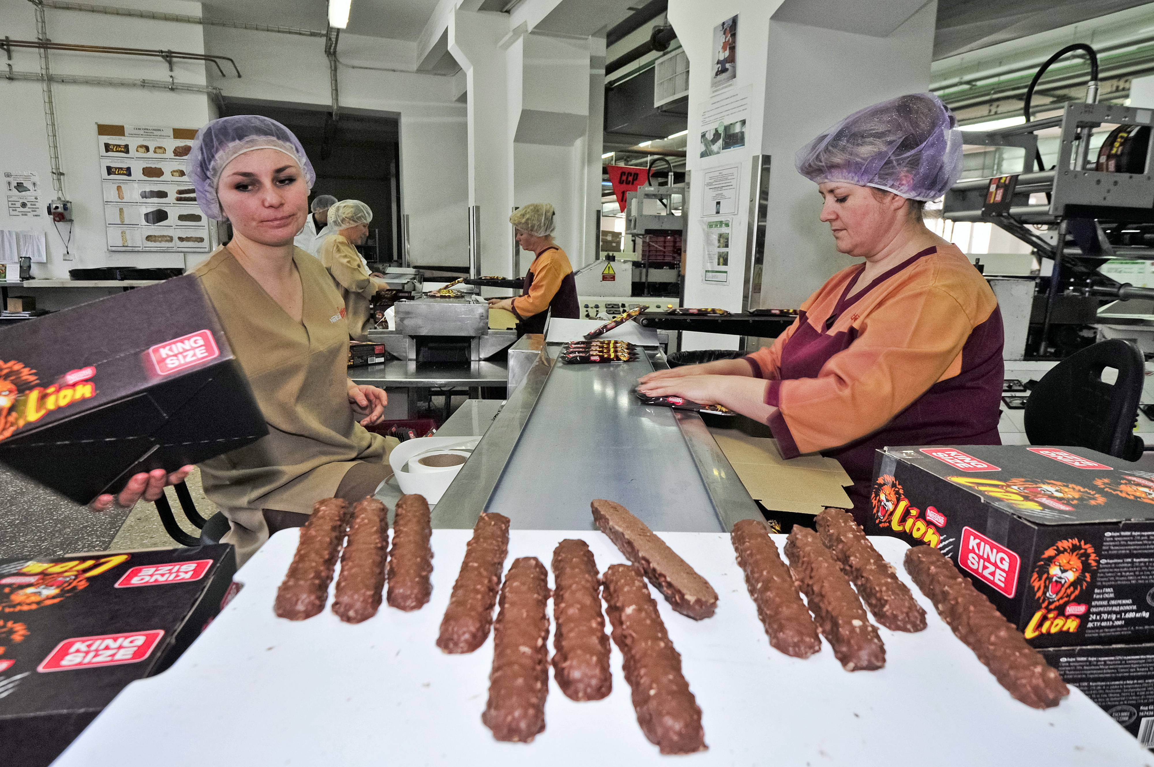 "Employees prepare Nestle SA king-size ""Lion"" chocolate bars ahead of packaging at the company's Svitoch factory. Nestle SA typically seeks to be first or second in all its businesses, yet isn't even close in the U.S. chocolate candy market."