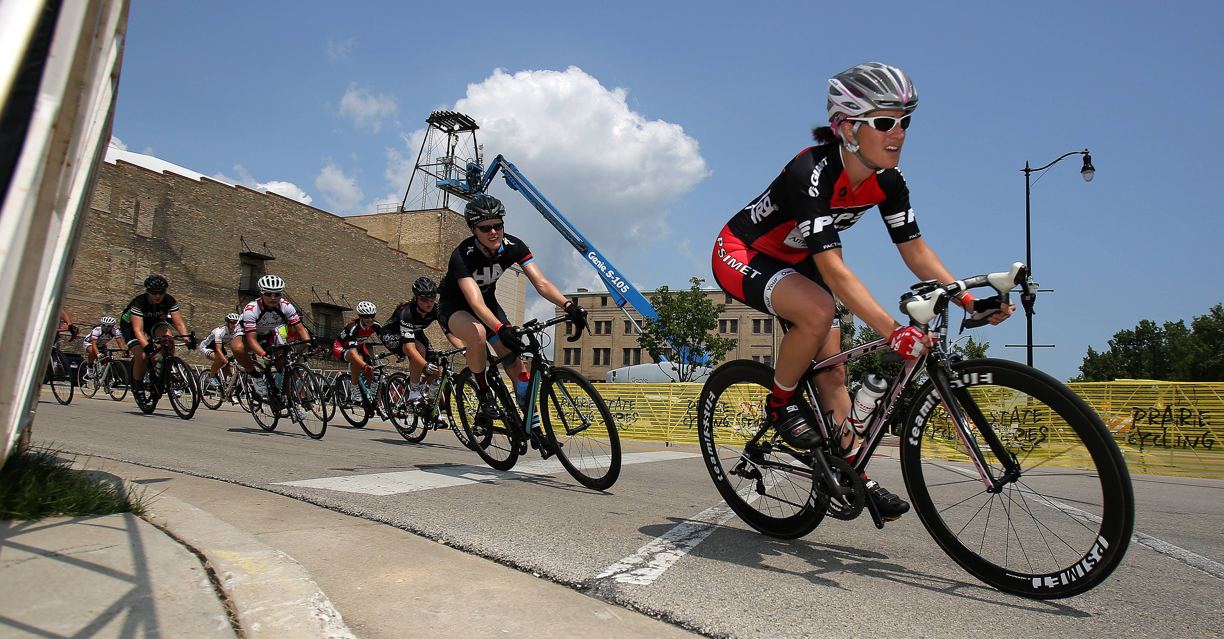 Category 5 women cyclers make their way onto Sheridan Road in downtown Waukegan during the inaugural Vista Health System Waukegan Criterium on Friday.