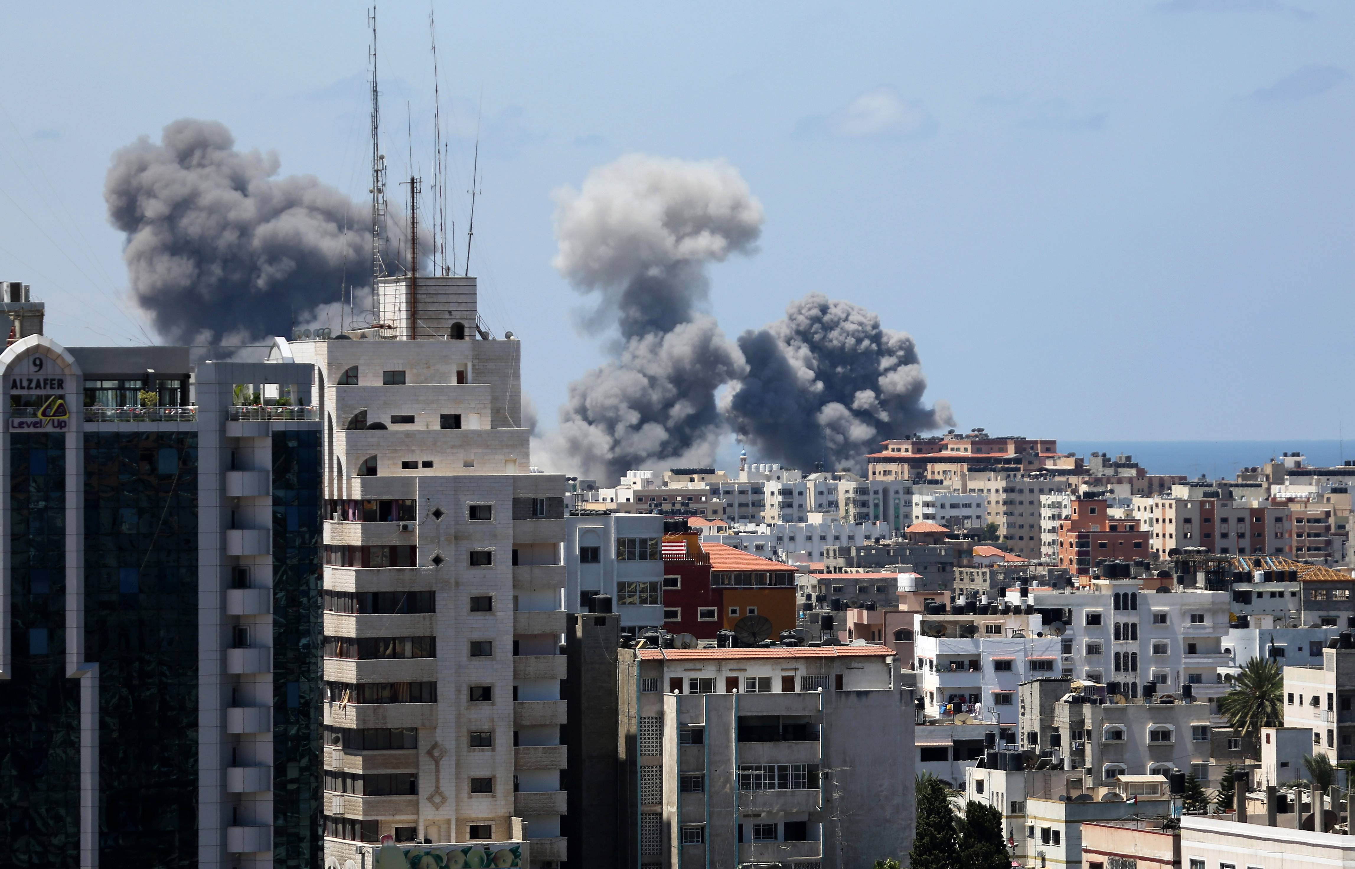 Smoke rises Friday after an Israeli missile strike in Gaza City. Israel intensified its 11-day campaign against Hamas by sending in tanks and troops late Thursday after becoming increasingly exasperated with unrelenting rocket fire from Gaza on its cities.