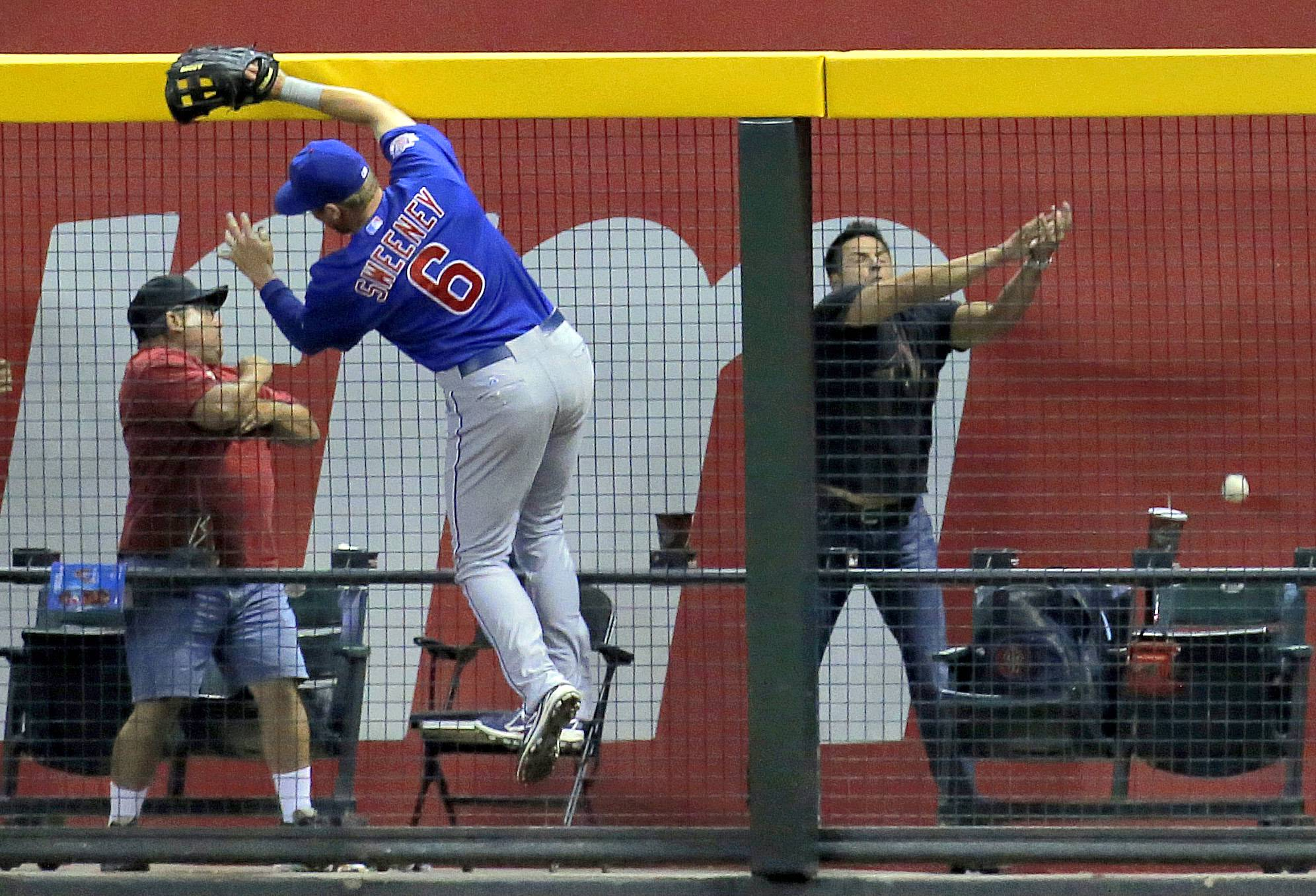 The Cubs' Ryan Sweeney can't catch a home run hit by the Diamondbacks' Paul Goldschmidt in the sixth inning Friday in Phoenix.