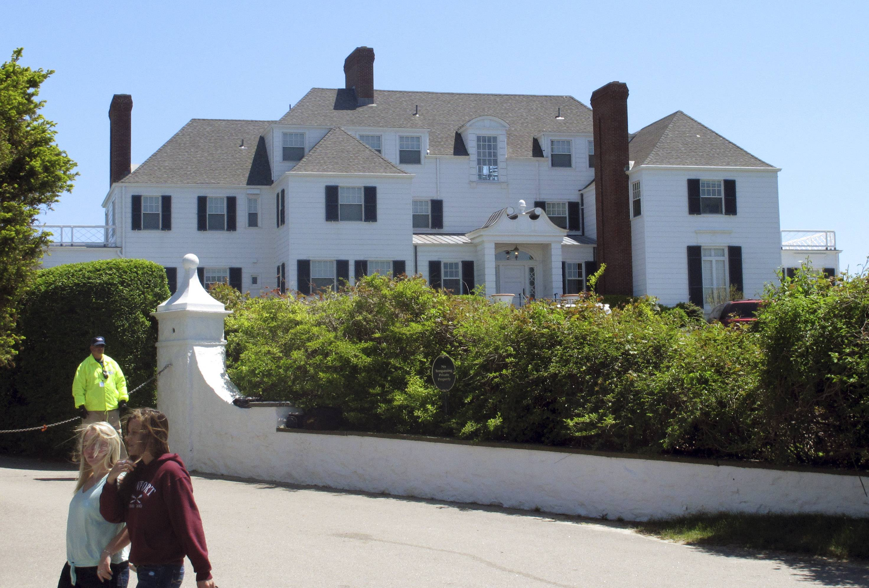 People walk past a house owned by Taylor Swift in the village of Watch Hill in Westerly, R.I. Daniel Cole, 39, of Brewster, Mass., was sentenced to probation Thursday, July 18, 2014, after being found guilty of trespassing at the seaside mansion.