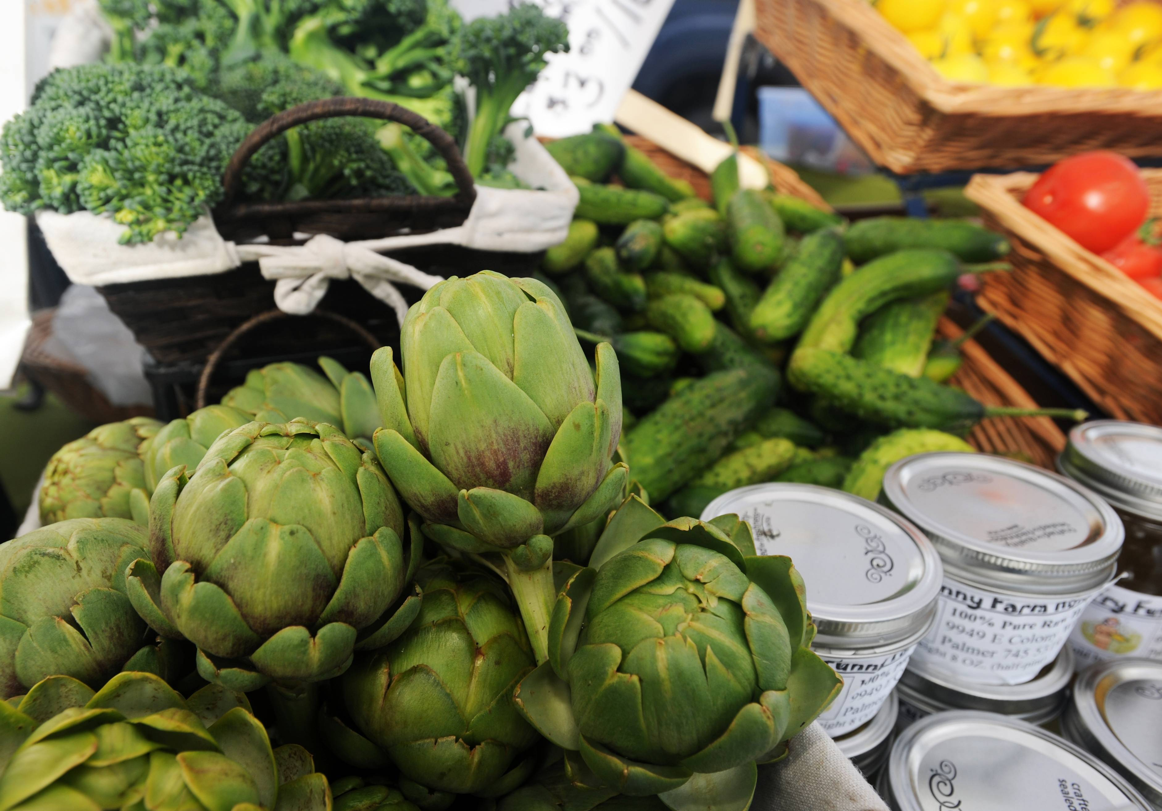 Artichokes and other vegetables are for sale at the Kenley's Alaskan Vegetables and Flowers stand at the South Anchorage Farmers Market in Anchorage, Alaska. Billed as Alaska's largest open air market, it's a must-stop for tourists in town on Saturdays and Sundays.